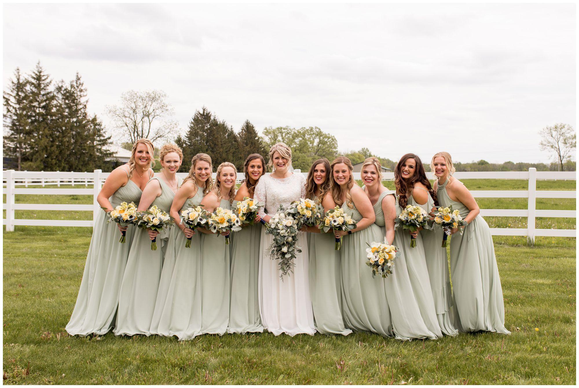 bride with bridesmaids before wedding ceremony in Muncie Indiana