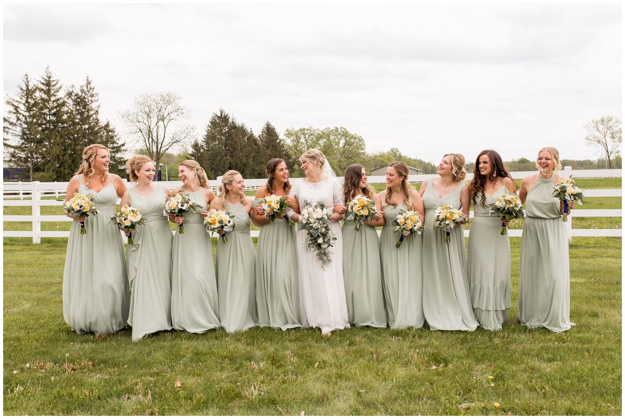 bride walks with bridesmaids at The Creek House at Burton Farms in Muncie