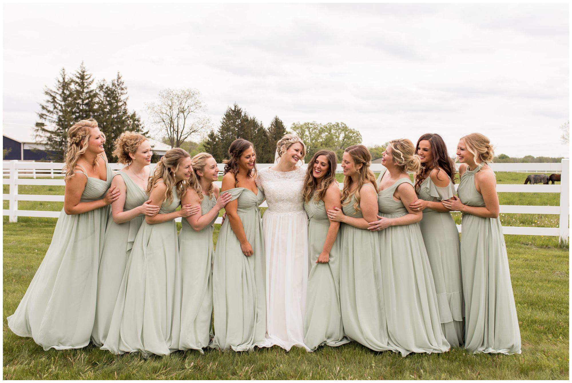bride laughs with bridemaids before wedding ceremony at Muncie First Church of the Nazarene