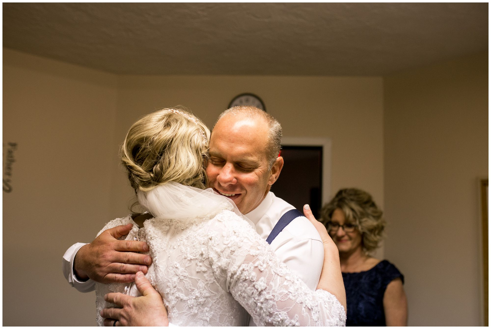 father of bride hugs daughter before wedding ceremony at Muncie First Church of the Nazarene