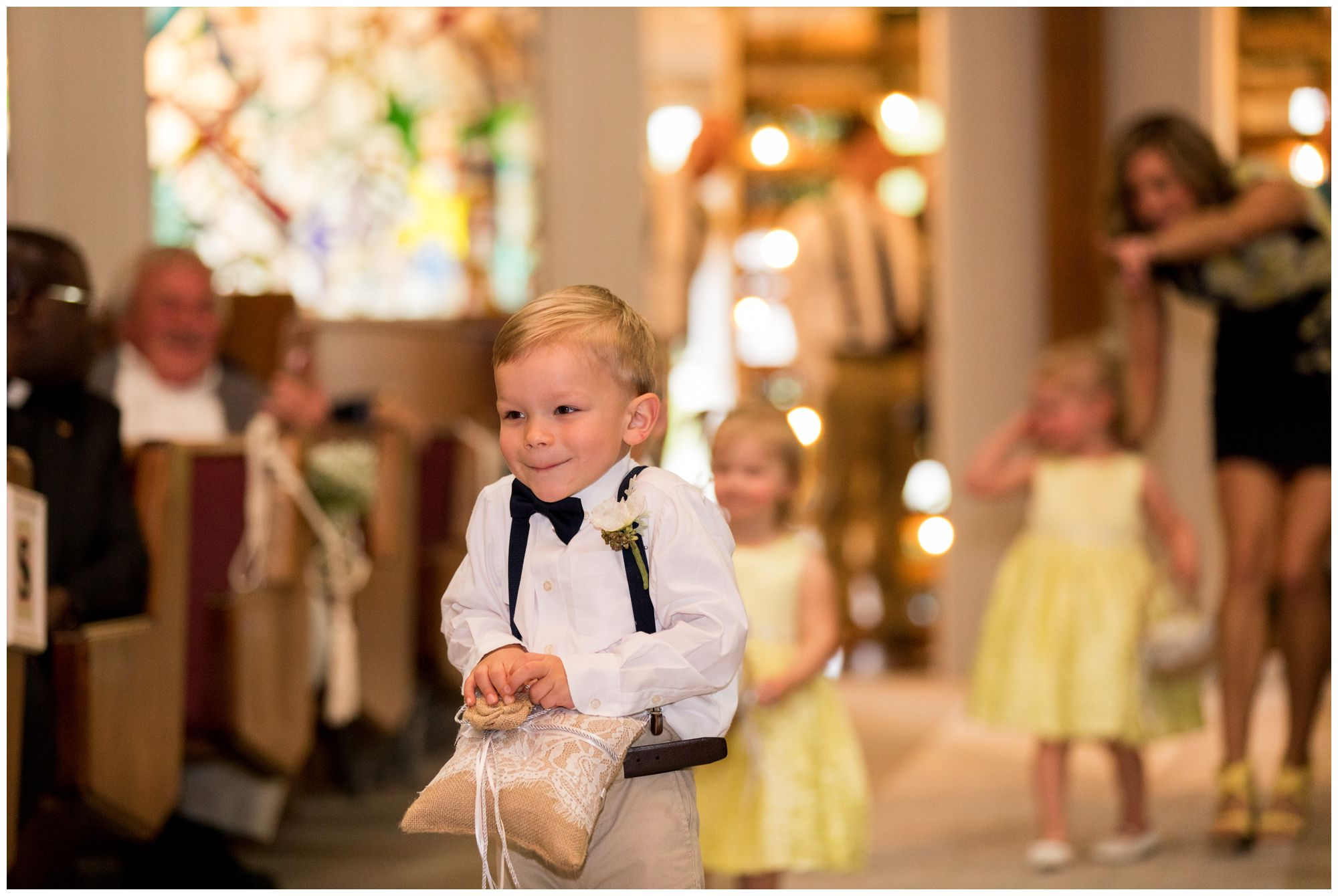 ring bearer comes down aisle during wedding ceremony in Muncie Indiana