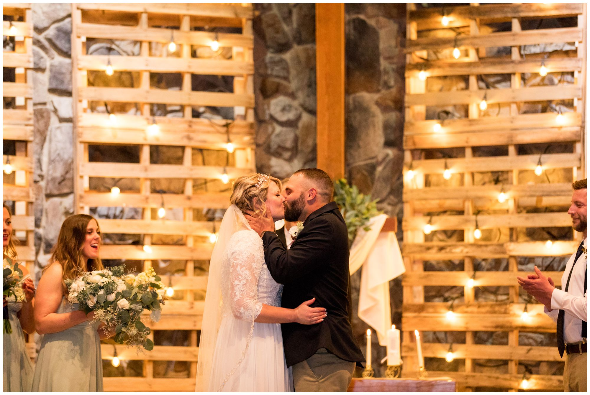 bride and groom first kiss at Muncie First Church of the Nazarene
