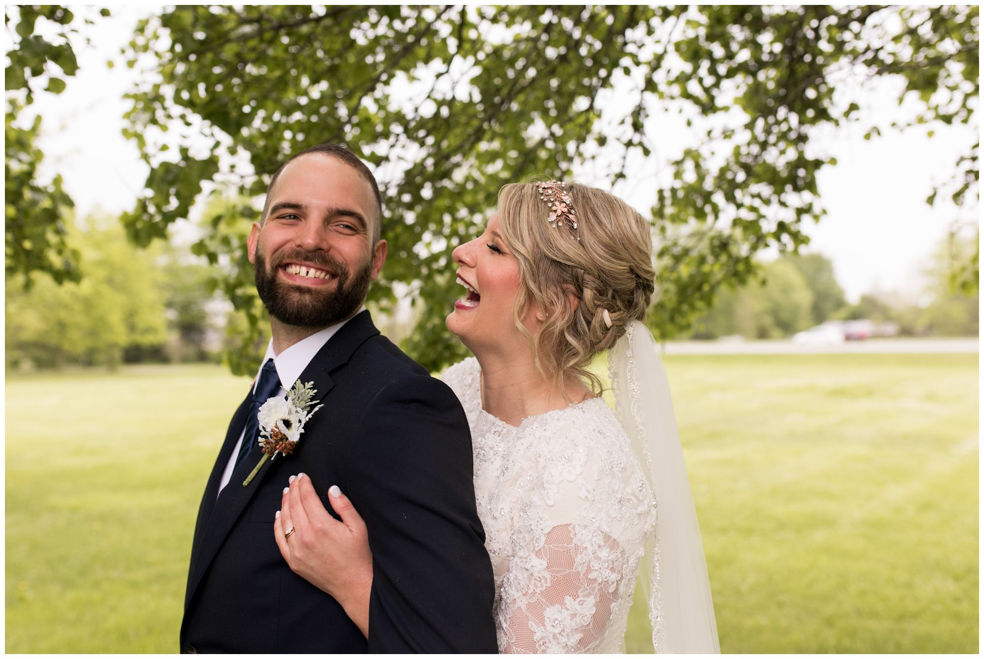 bride and groom laugh together during couples portraits after Muncie Indiana wedding ceremony