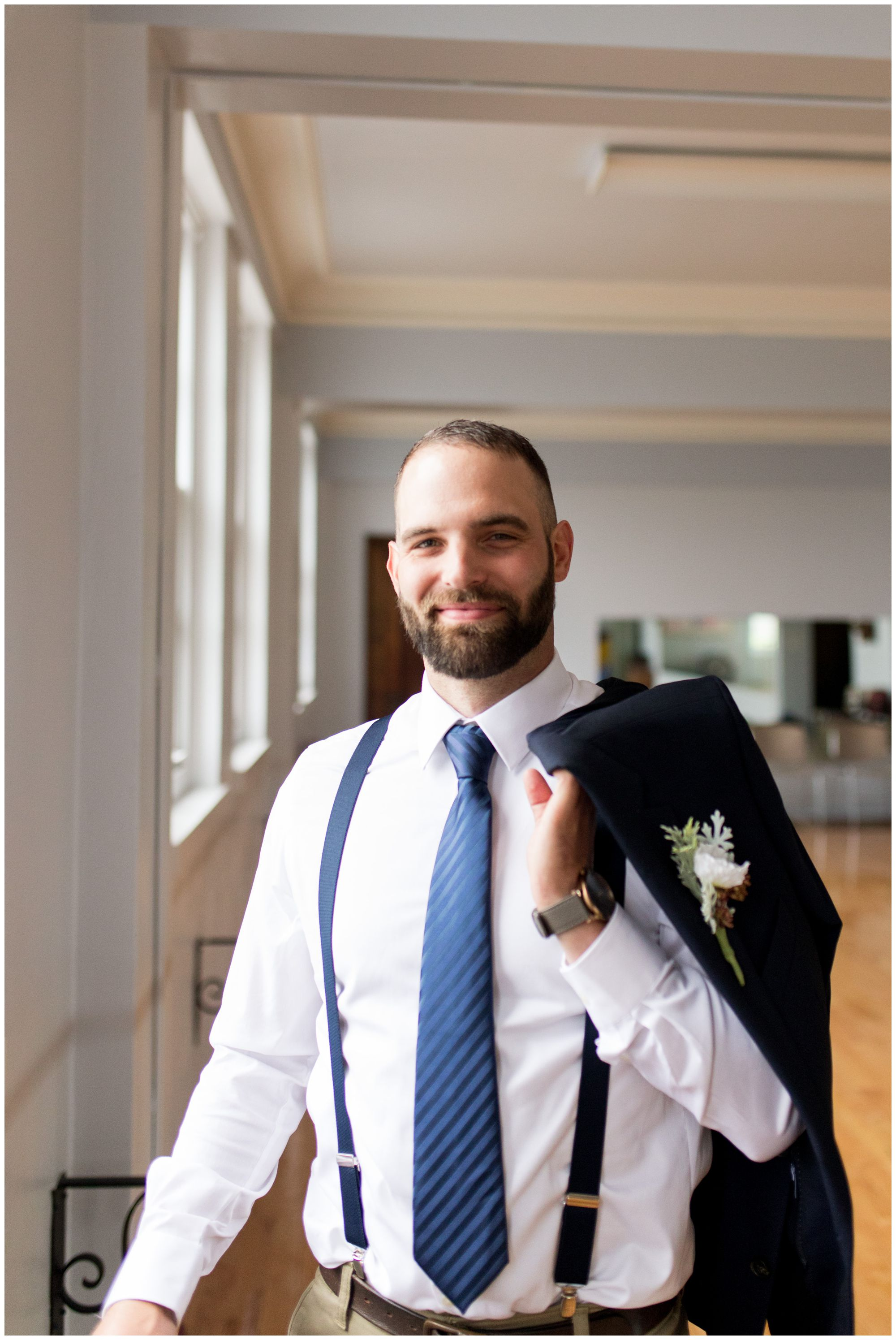 groom portraits at Cornerstone Center for the Arts wedding in Muncie Indiana
