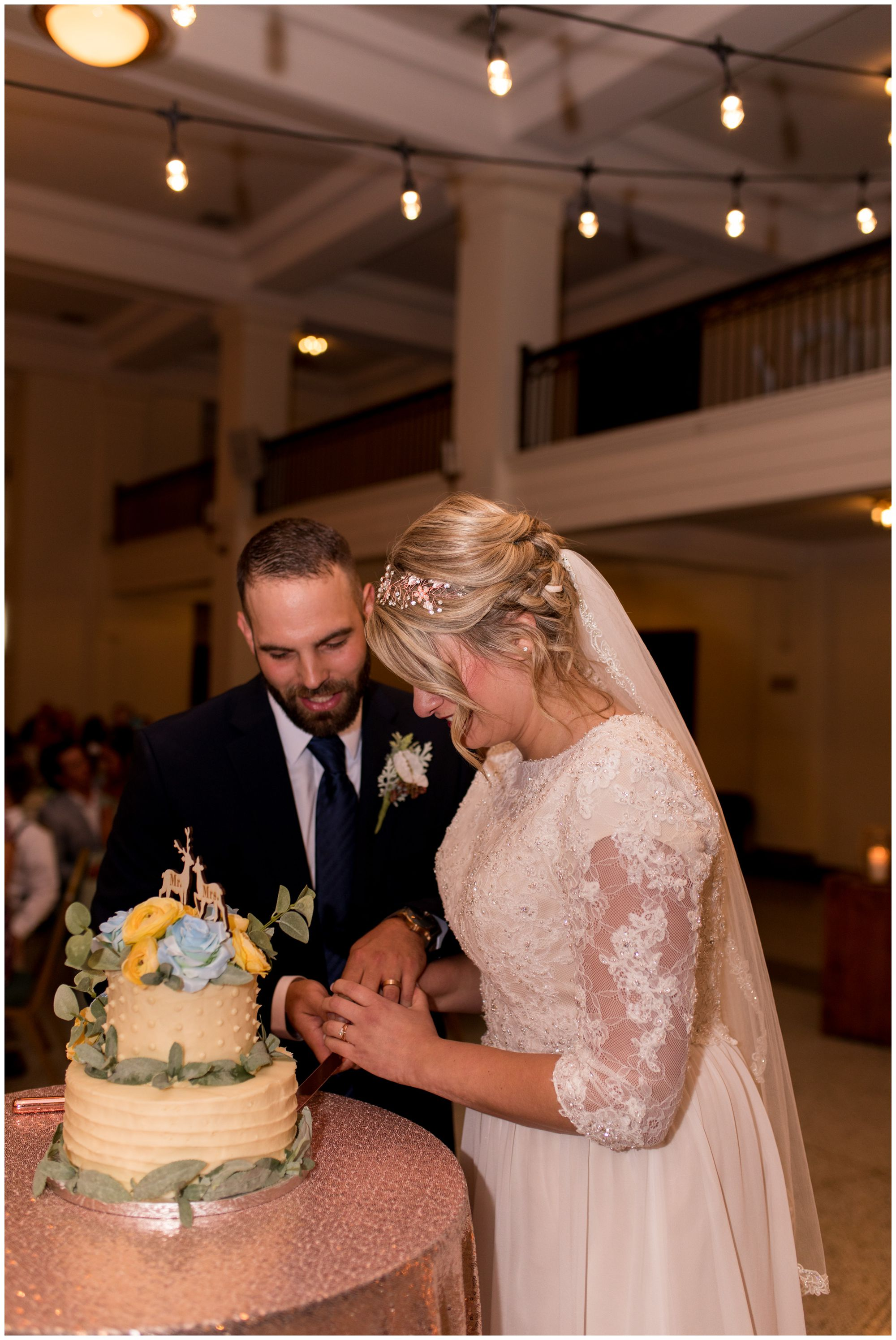 bride and groom cut wedding cake at Cornerstone Center for the Arts in Muncie Indiana