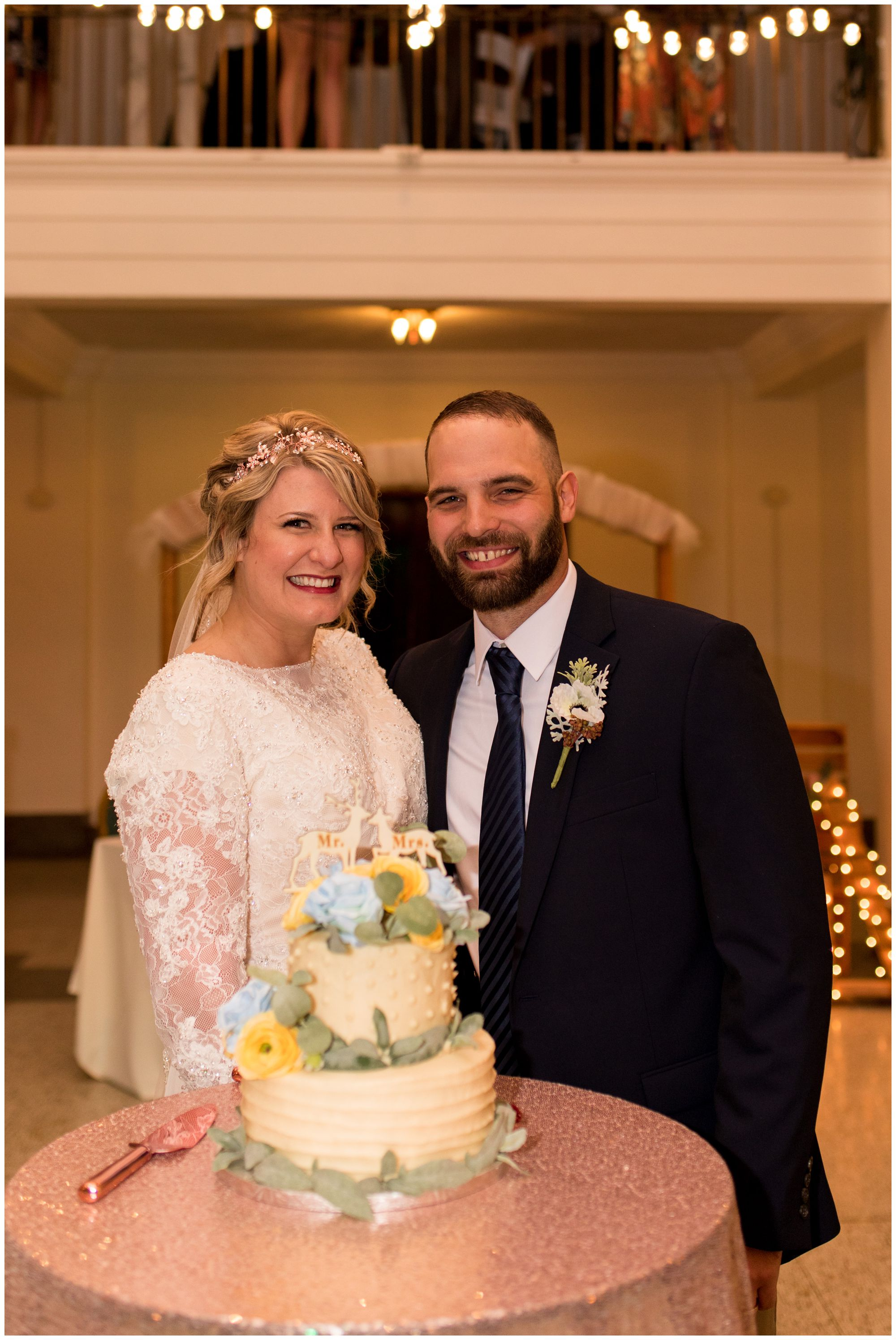 bride and groom with cake at Cornerstone Center for the Arts in Muncie Indiana