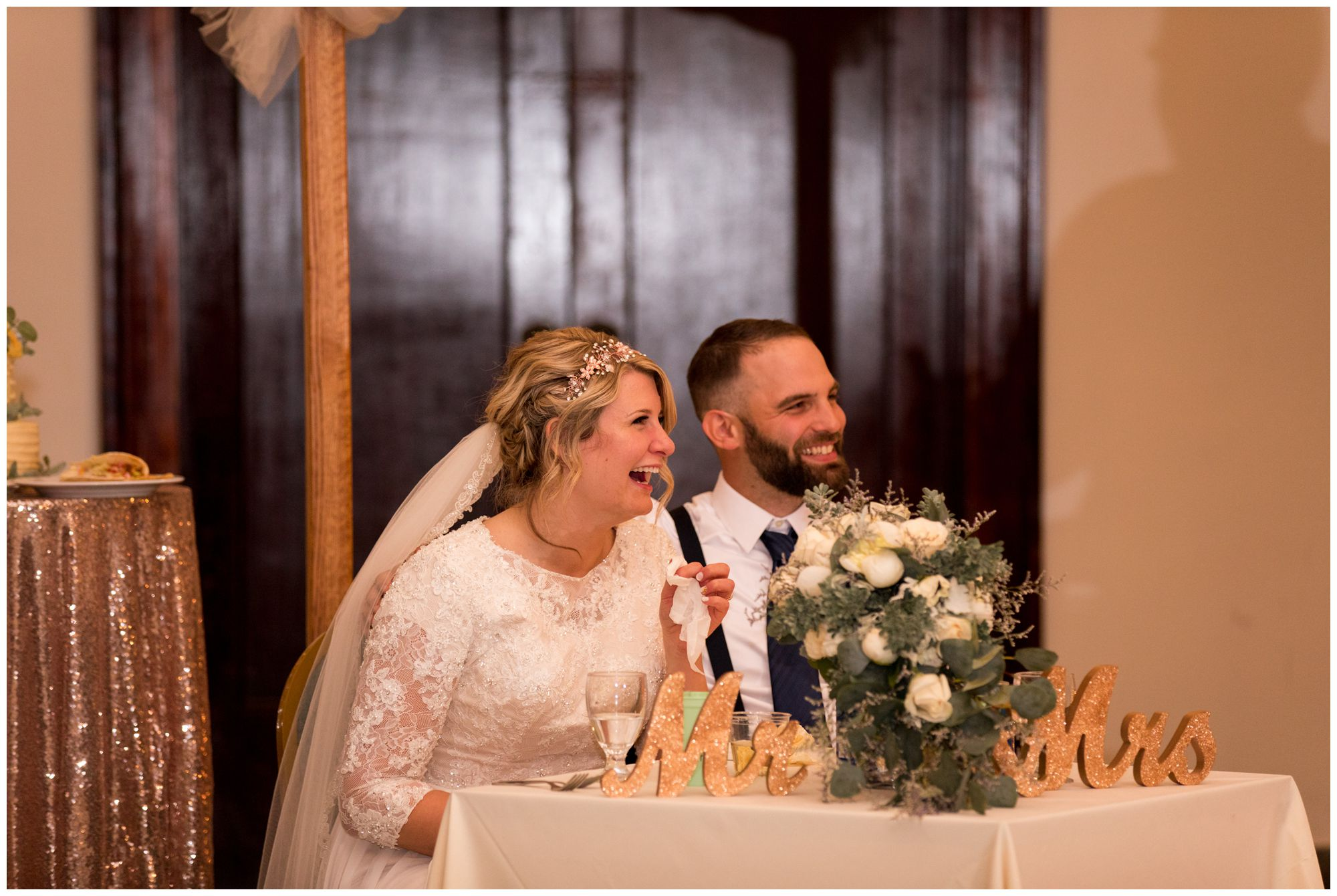 bride and groom laugh during wedding reception toasts at Cornerstone Center for the Arts in Muncie Indiana