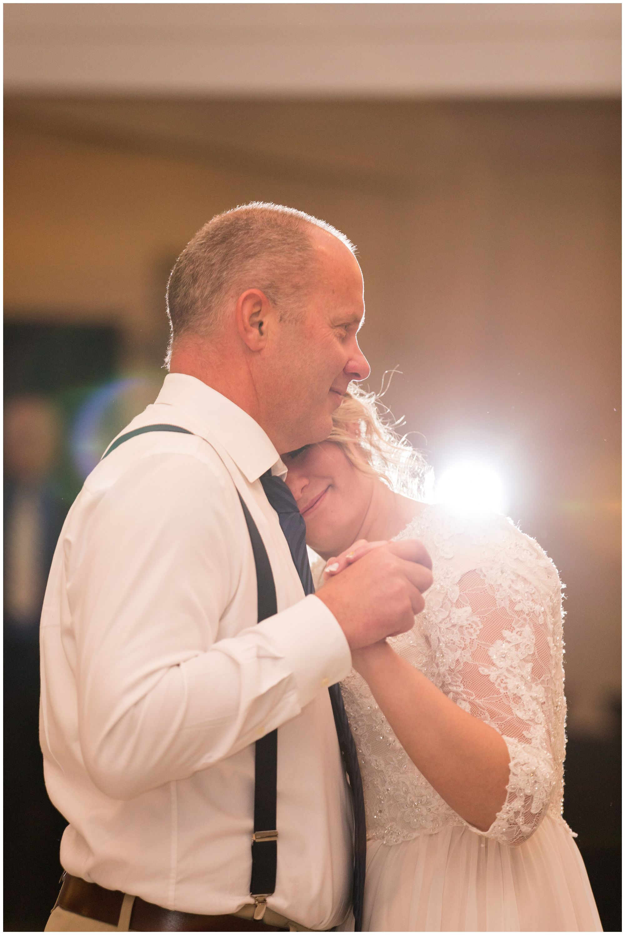 bride and father dance together during wedding reception at Cornerstone Center for the Arts in Muncie Indiana