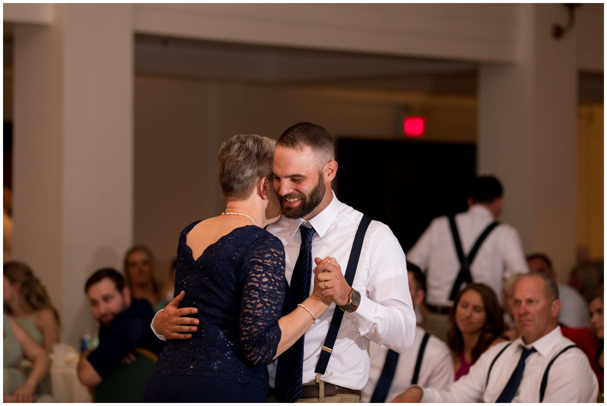 groom and mom dance together at Cornerstone Center for the Arts Muncie Indiana wedding reception