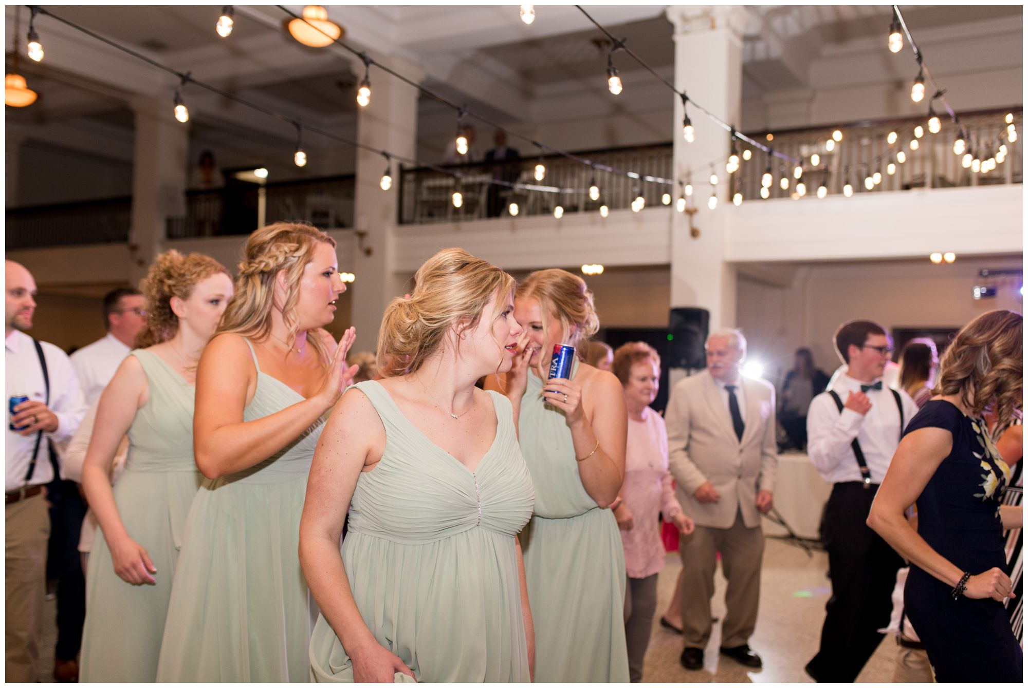 bridesmaids dance during wedding reception at Cornerstone Center for the Arts in Muncie Indiana