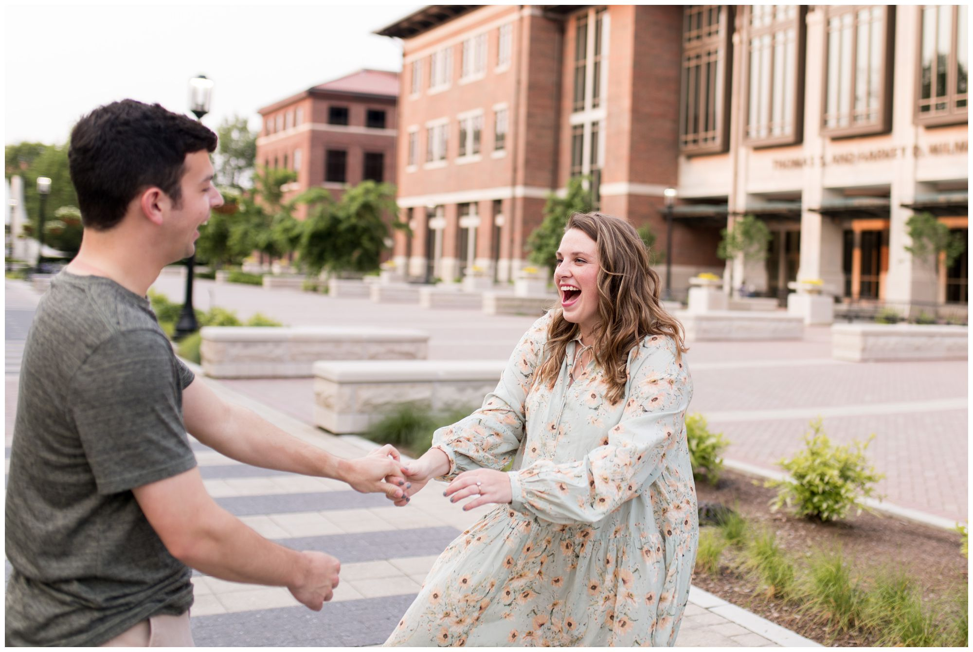 bride and groom dance near bell tower at Purdue University engagement session