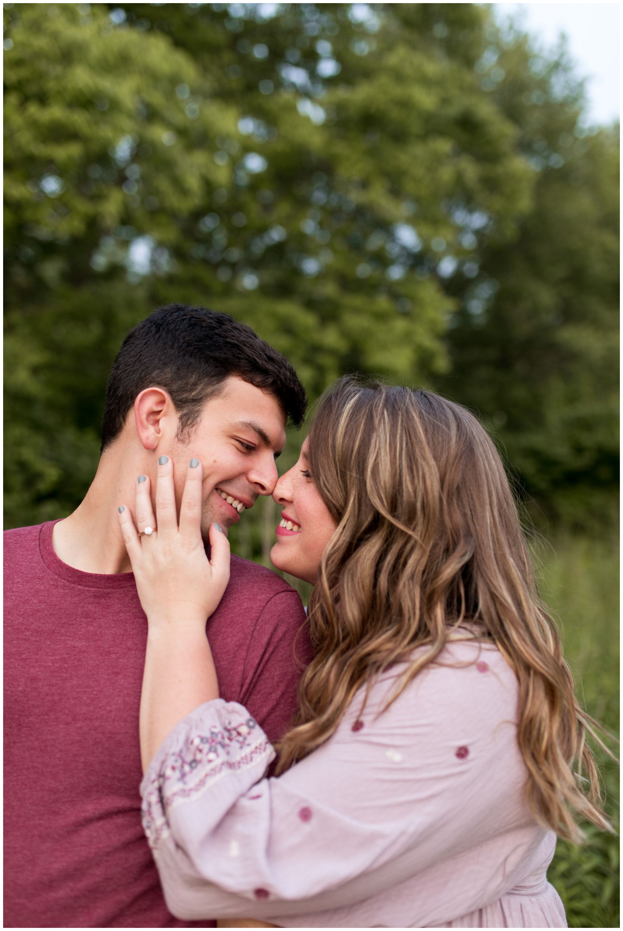 bride touching groom's face during Lafayette Indiana engagement session at Prophetstown State Park