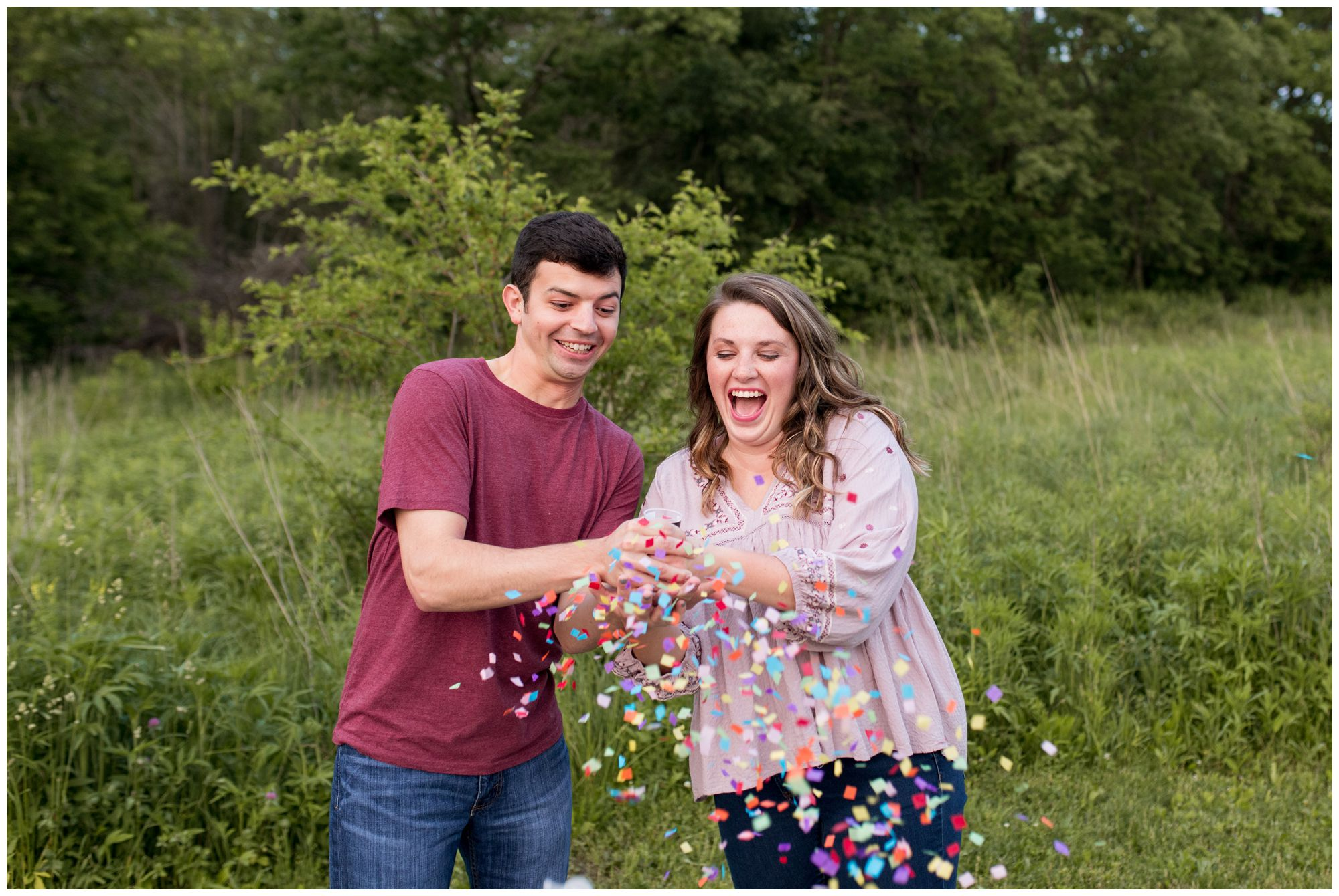 bride and groom release confetti during Lafayette Indiana engagement session at Prophetstown State Park