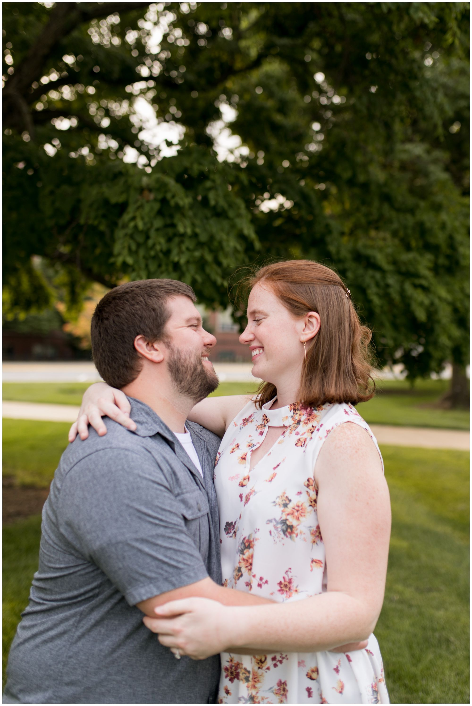 bride and groom laugh during engagement session at Purdue Unversity in West Lafayette, Indiana