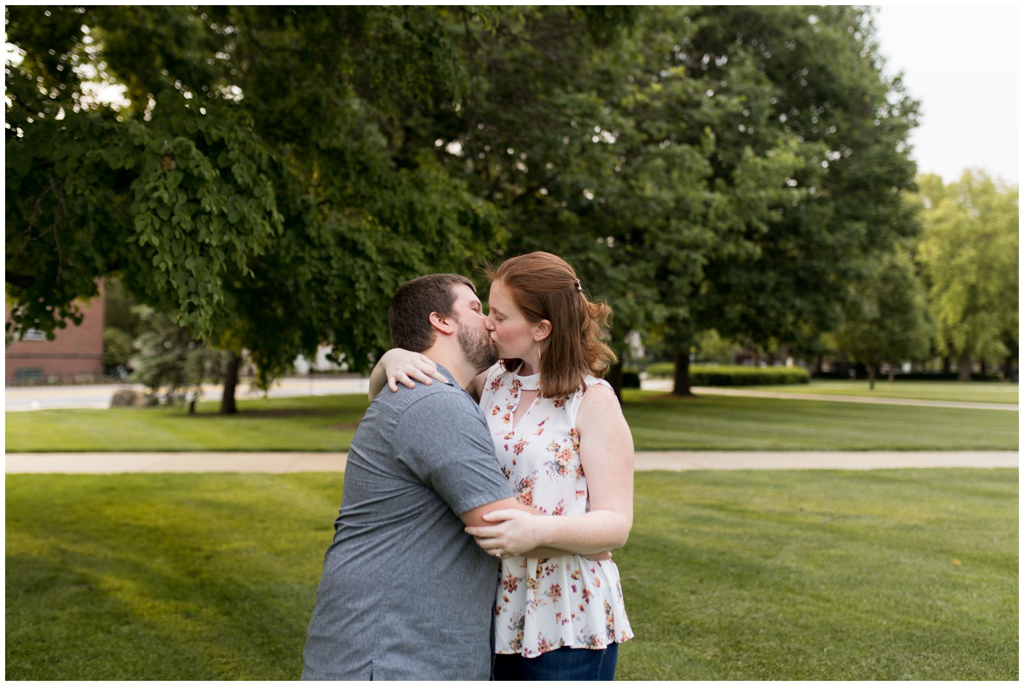 couple kisses during engagement session at Purdue University in West Lafayette, Indiana