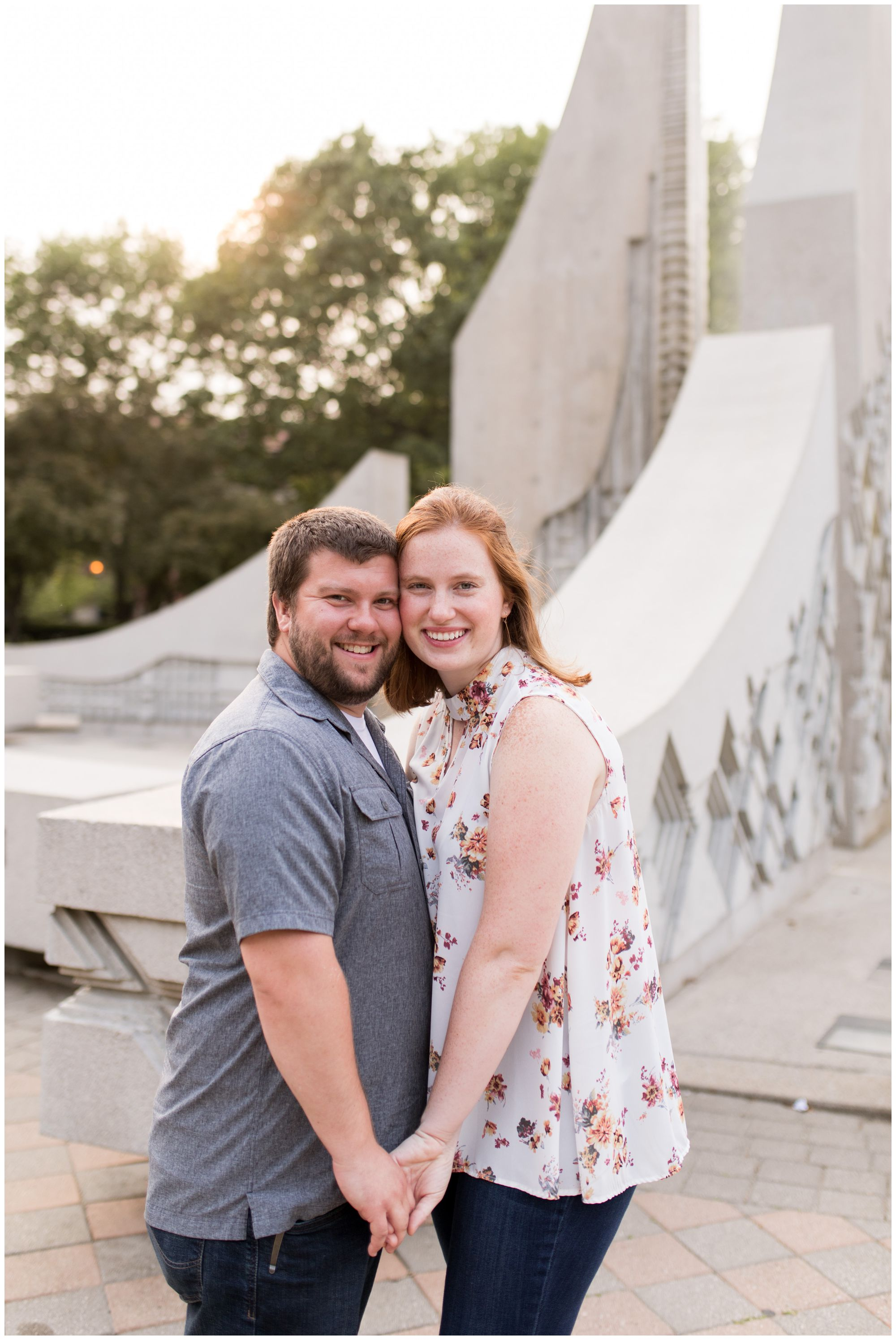 couple holds hands in front of engineering fountain at Purdue University engagement session