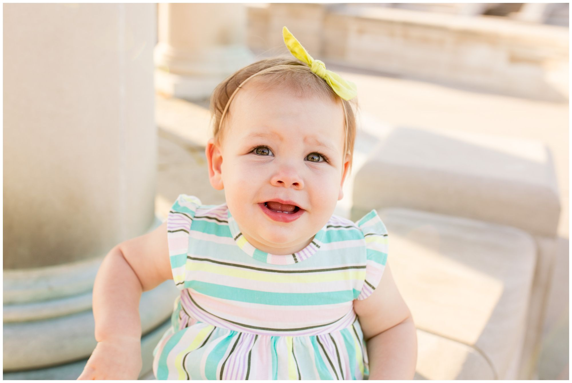 baby smiling at camera during family session at Coxhall Gardens in Carmel, Indiana