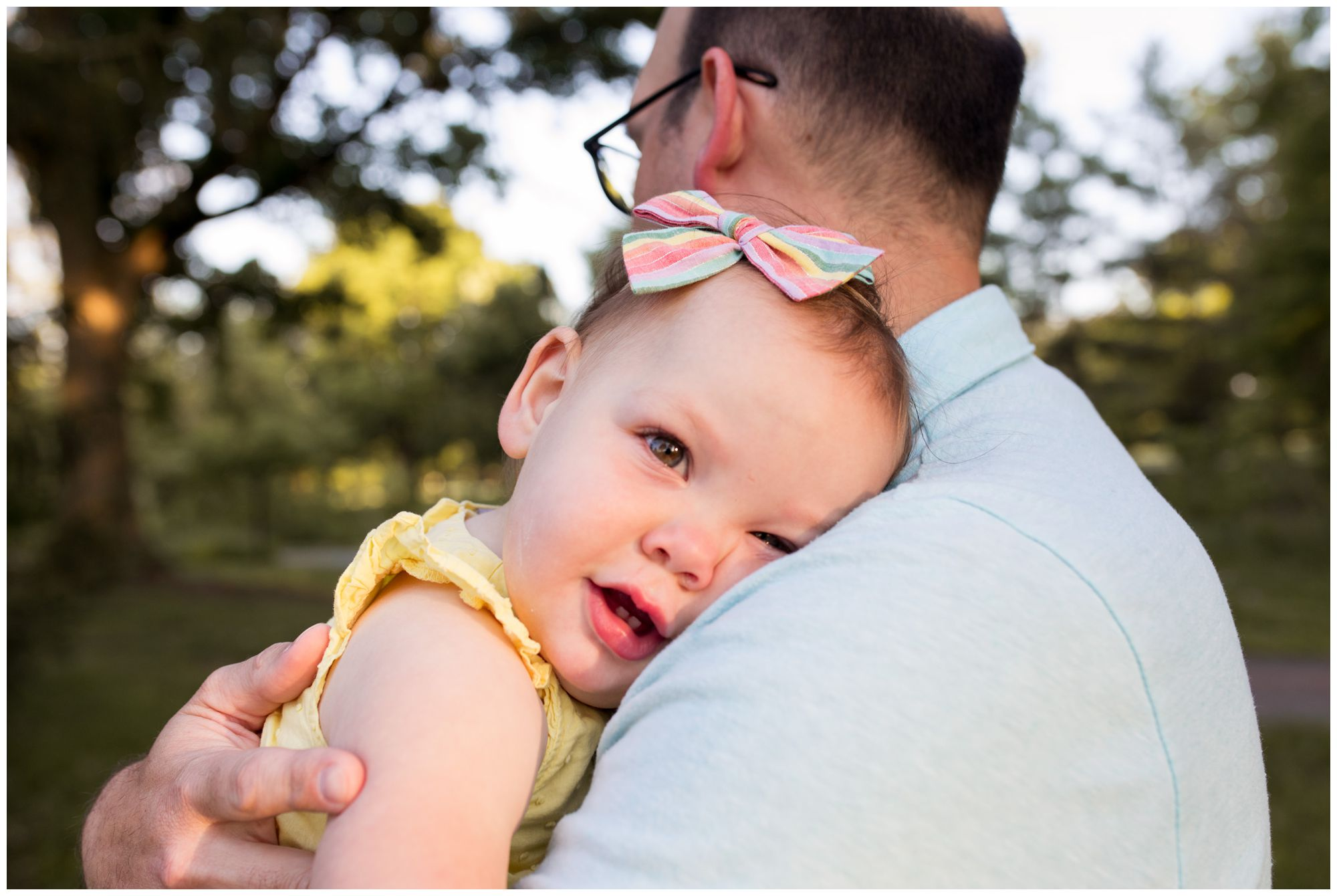 dad holds baby at Coxhall Gardens family session in Carmel Indiana