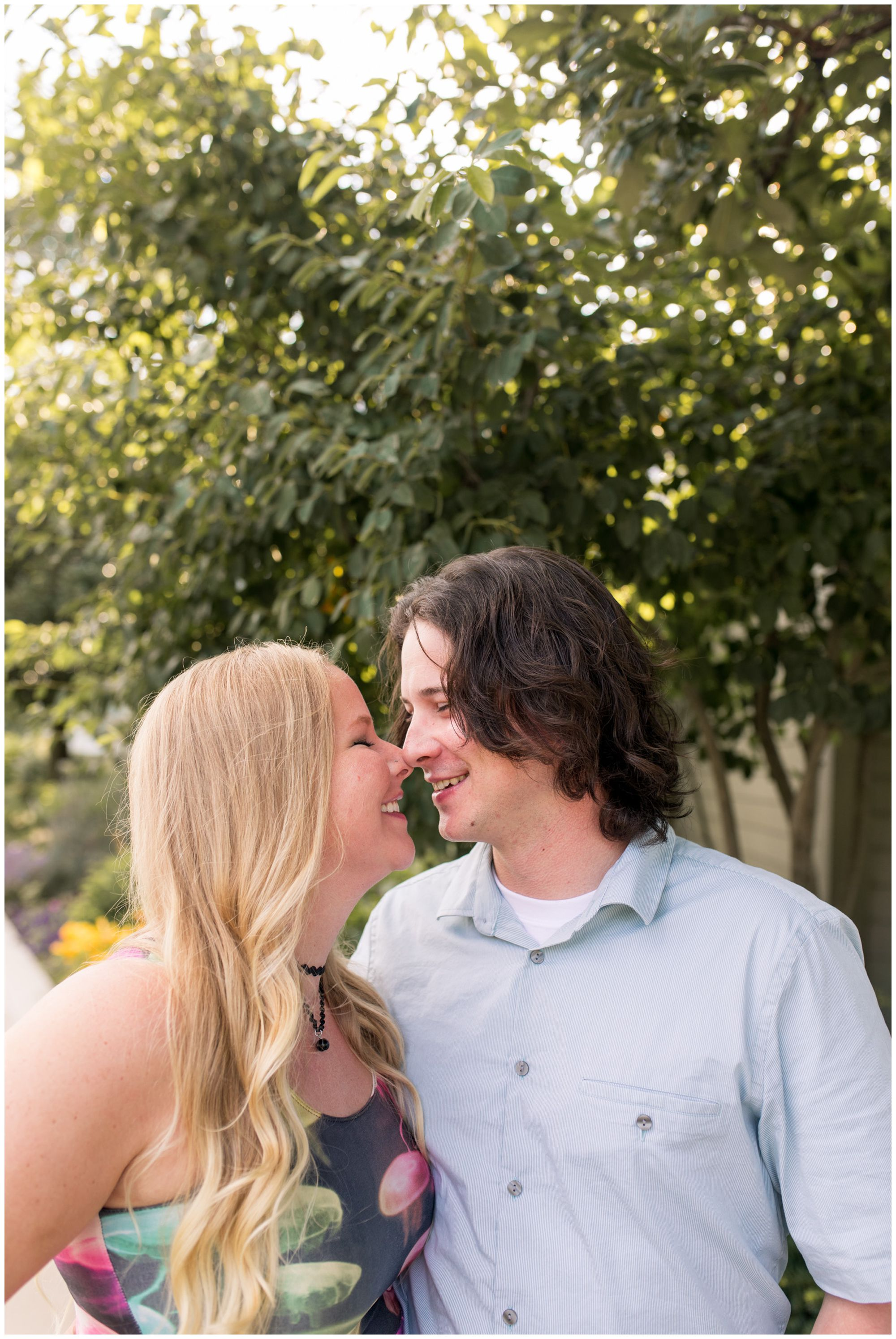 couple touch noses during engagement session at Broad Ripple Indiana