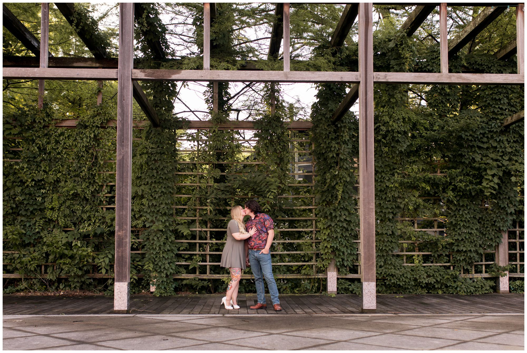 couple kissing at Indianapolis Art Center engagement session in Broad Ripple
