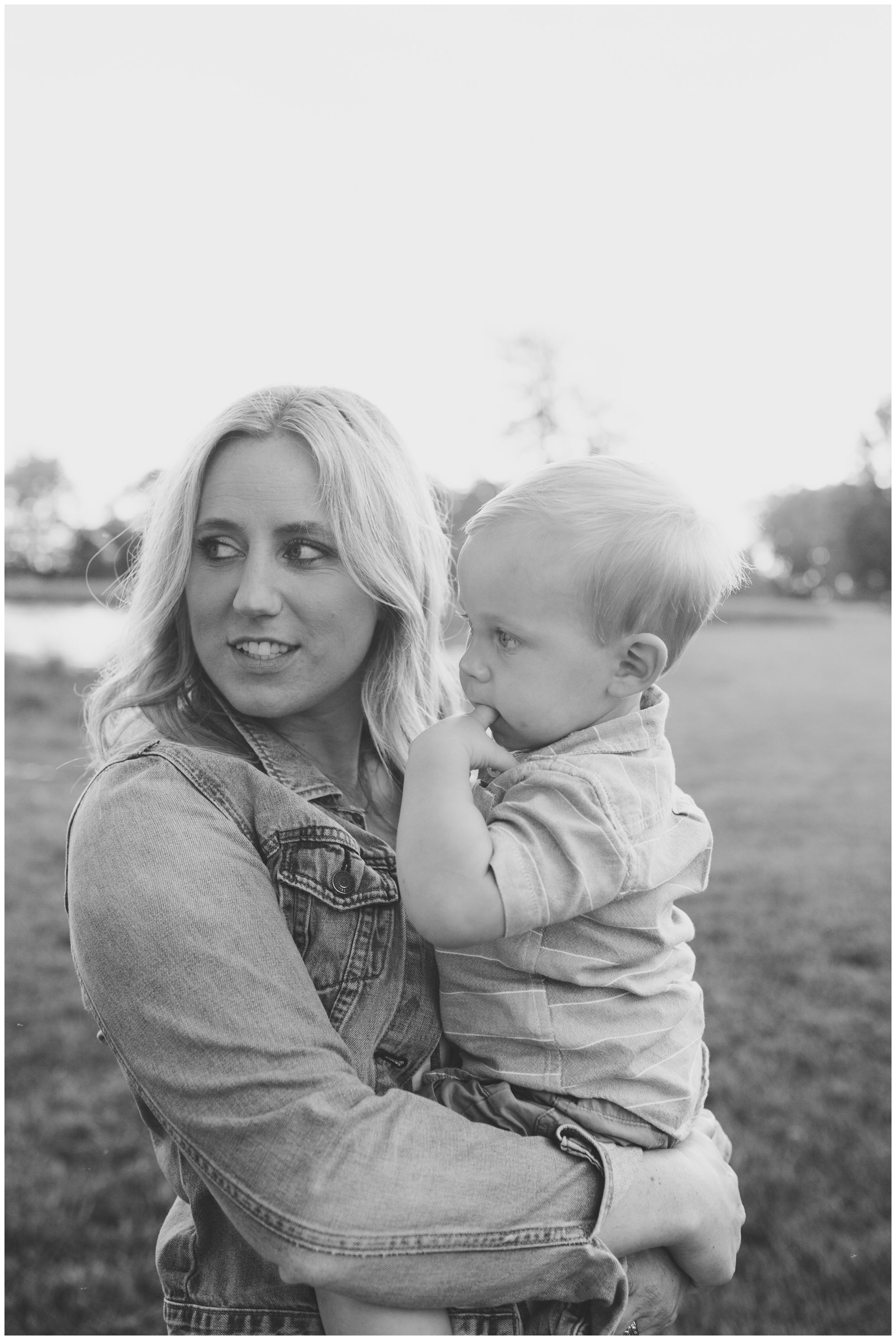 mom with youngest son during family session at Wildkat Creek Reservoir Park