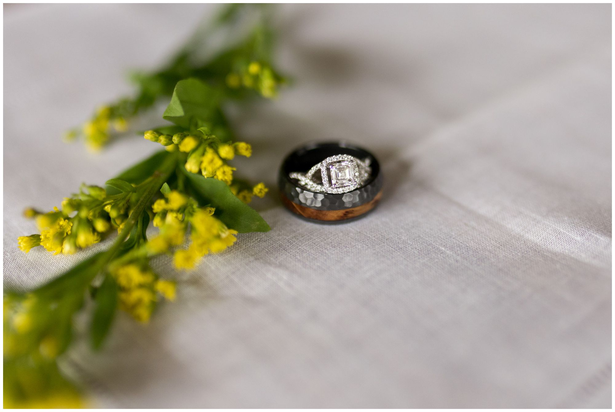 bride and grooms wedding rings with floral details at Indianapolis wedding