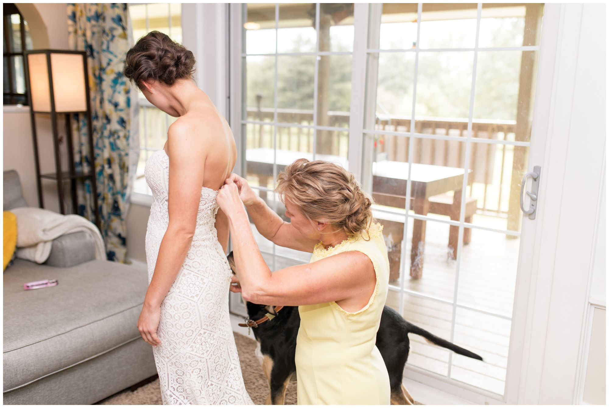 bride's mother buttoning Sophia's Bridal and Tux dress before Indianapolis wedding