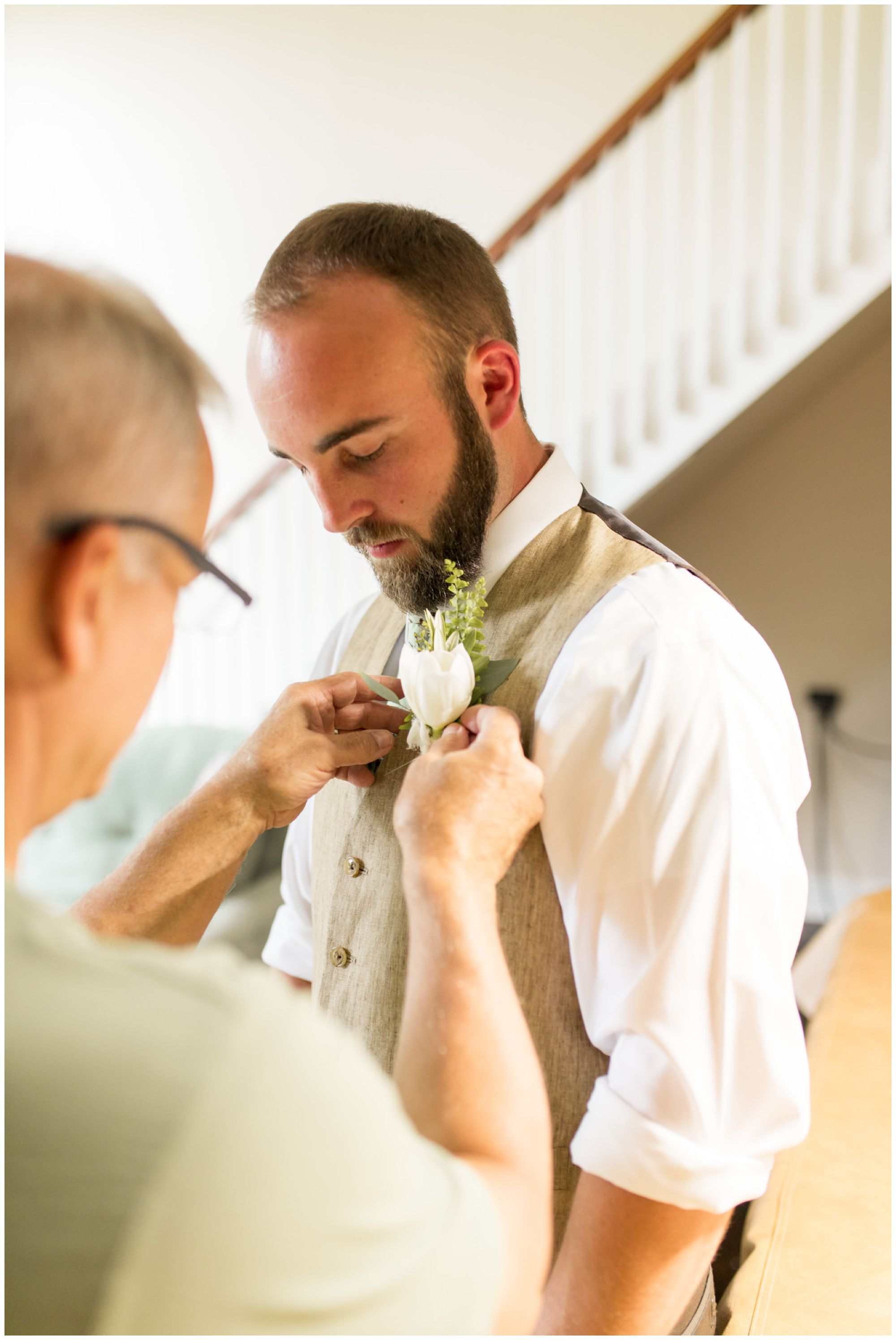 groom's father pins boutonniere from Jen's Stems on groom before Indianapolis wedding