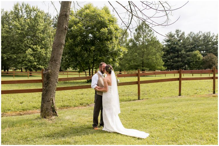 bride and groom first look before rustic Indianapolis backyard wedding ceremony