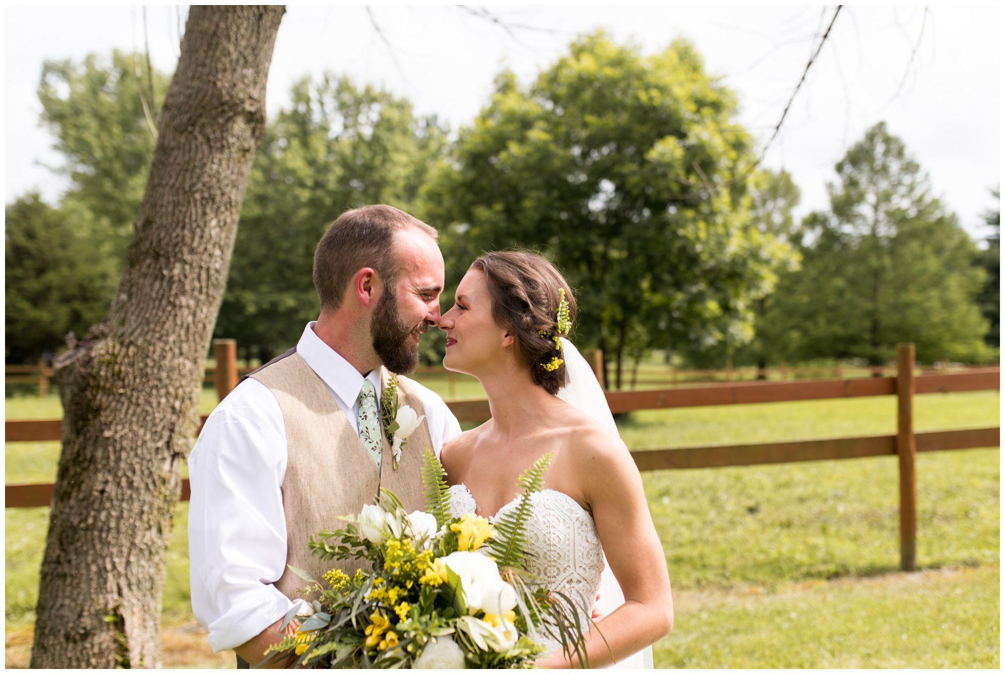 bride and groom touch noses during Indianapolis wedding portraits