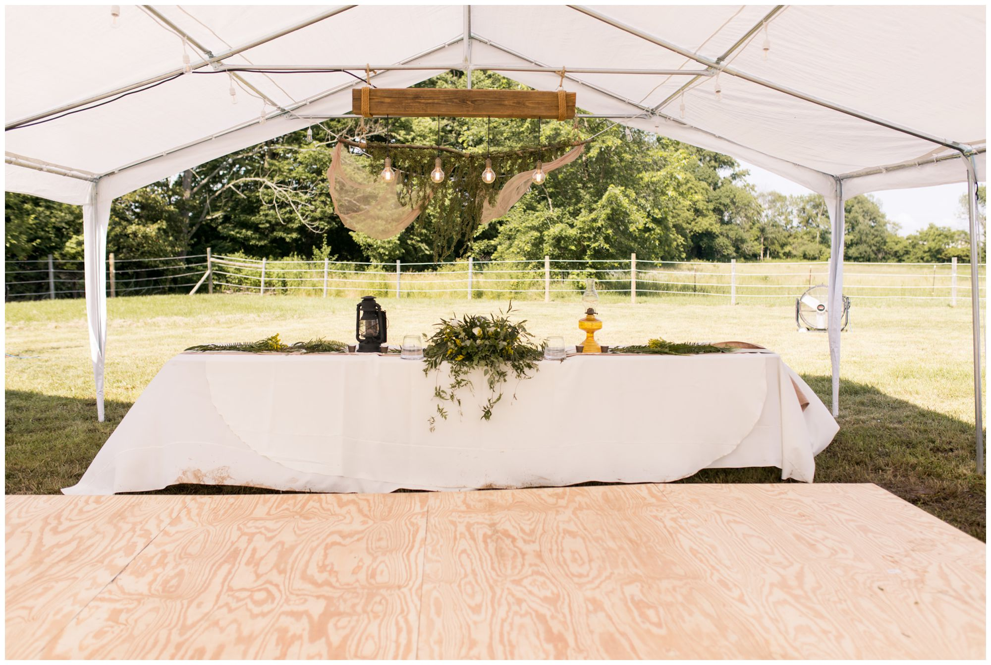 rustic Indianapolis backyard wedding reception decor with lanterns and table numbers