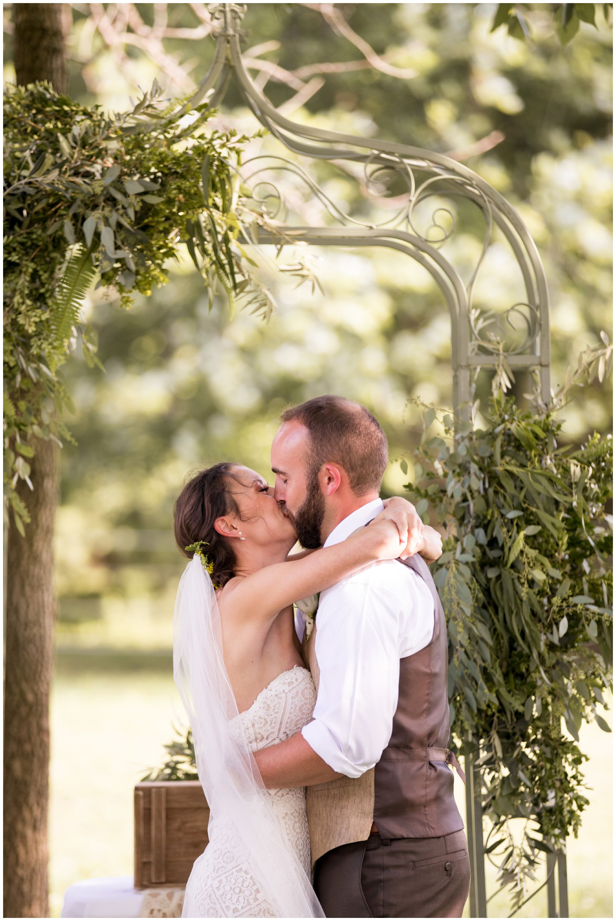 bride and groom first kiss as husband and wife at Indianapolis wedding ceremony