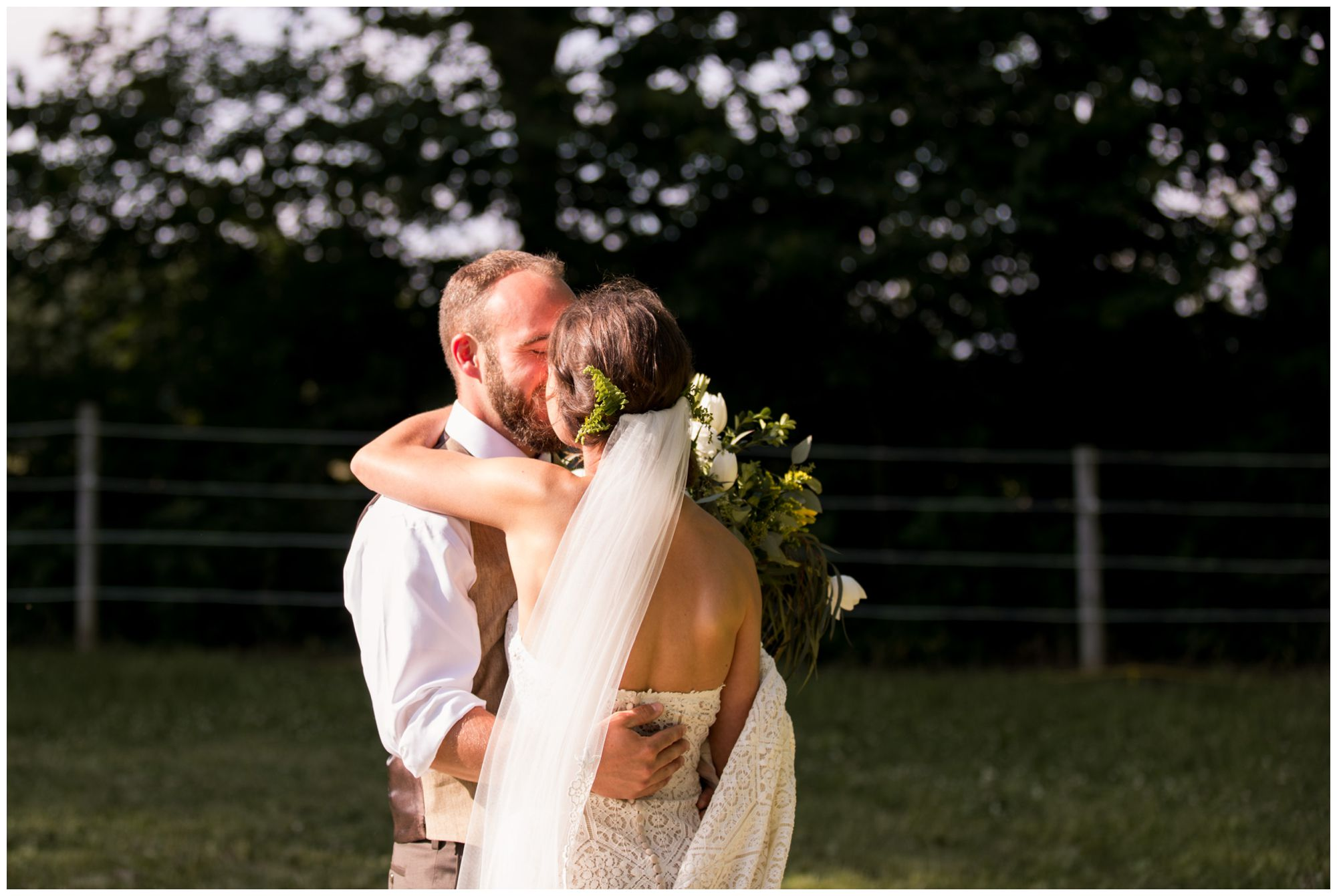 bride and groom sneak off for kiss after wedding ceremony in Indianapolis