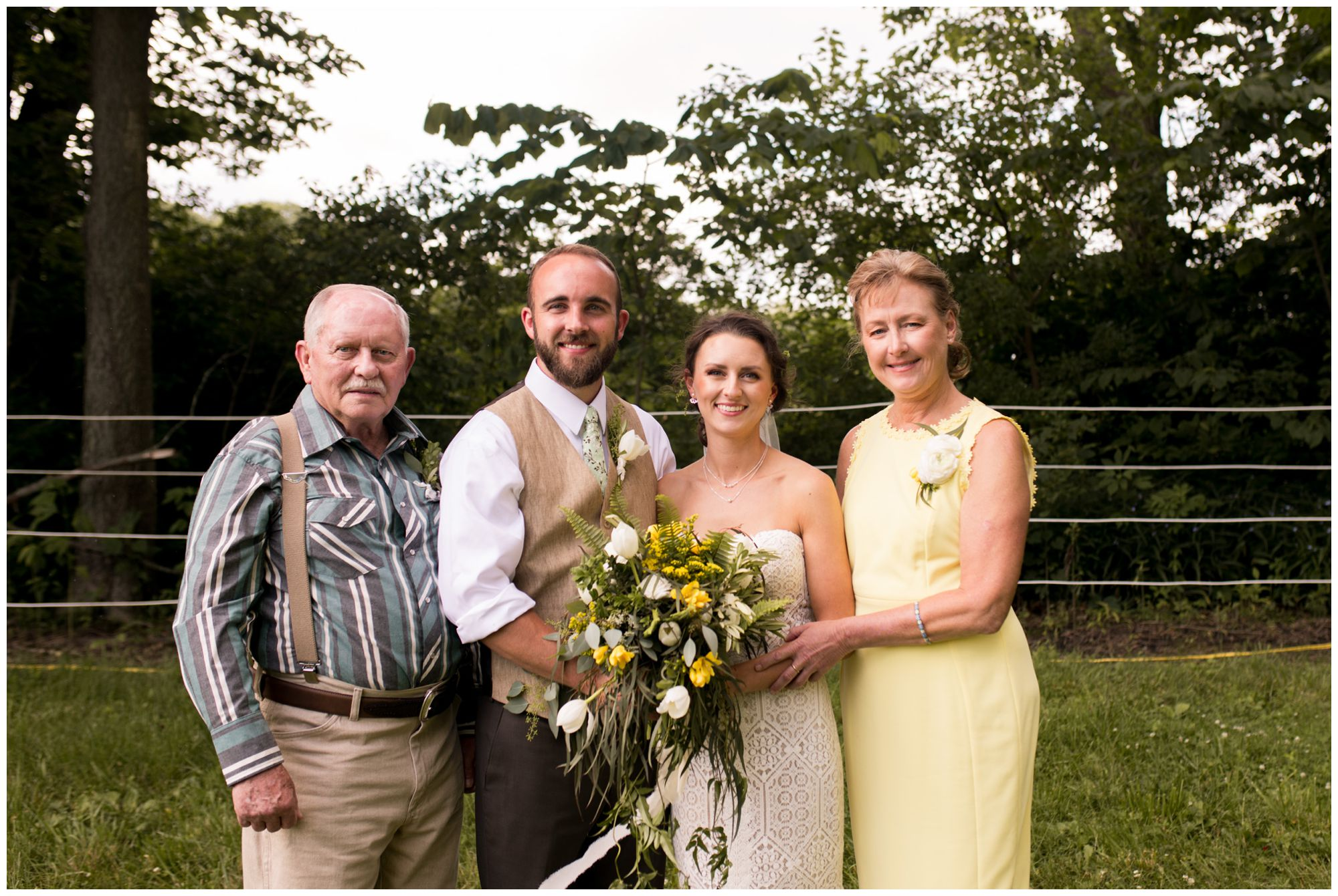 bride and groom with bride's mom and dad family formal portrait