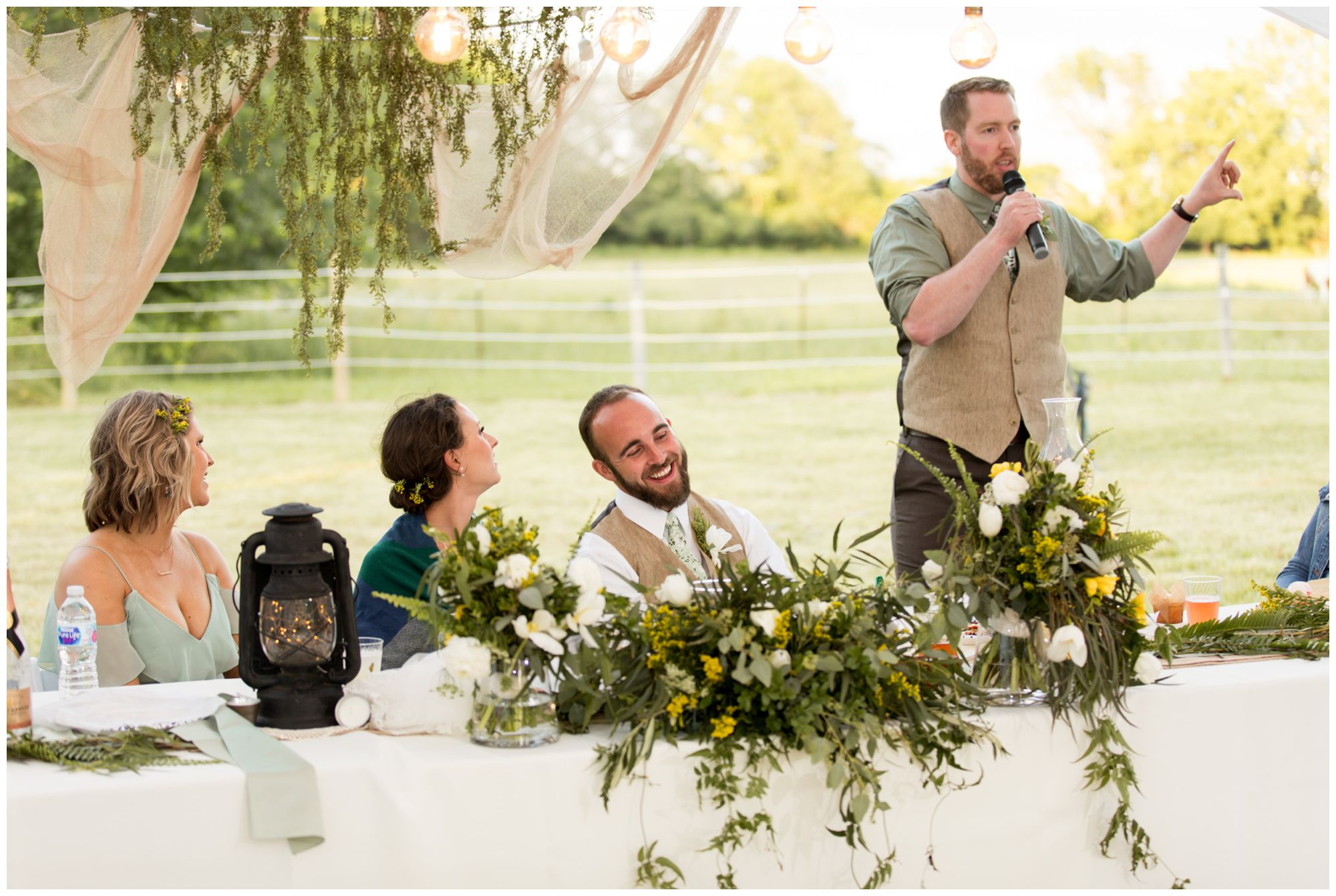 best man gives toast to bride and groom at rustic Indianapolis tented wedding reception