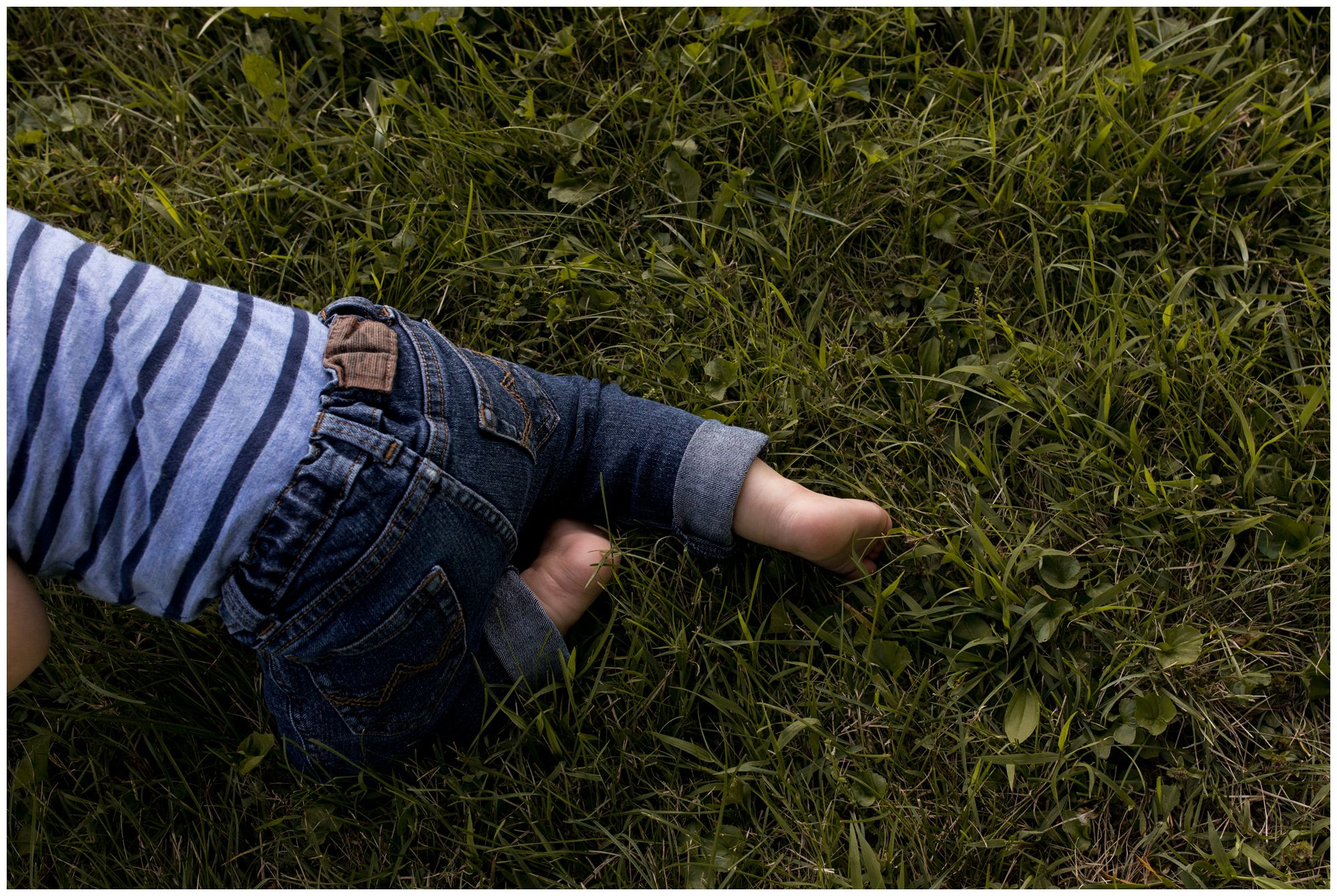 closeup details of little boy's feet during family session at Kokomo Reservoir