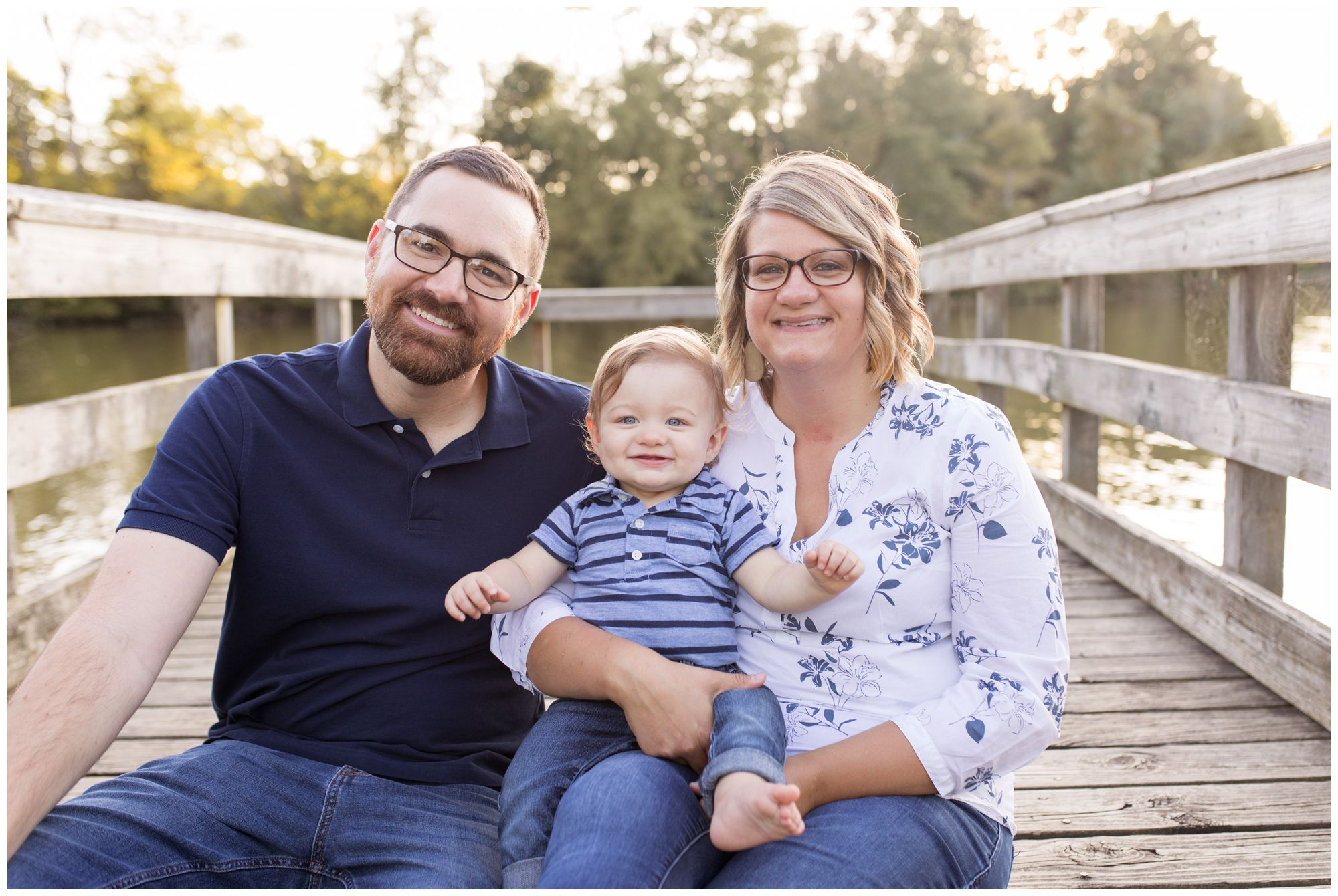 mom and dad with son during family session at Kokomo Reservoir