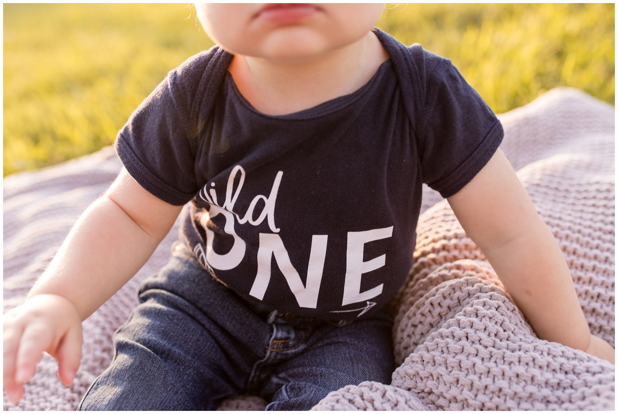 wild one onesie for boy's first birthday during Kokomo family session