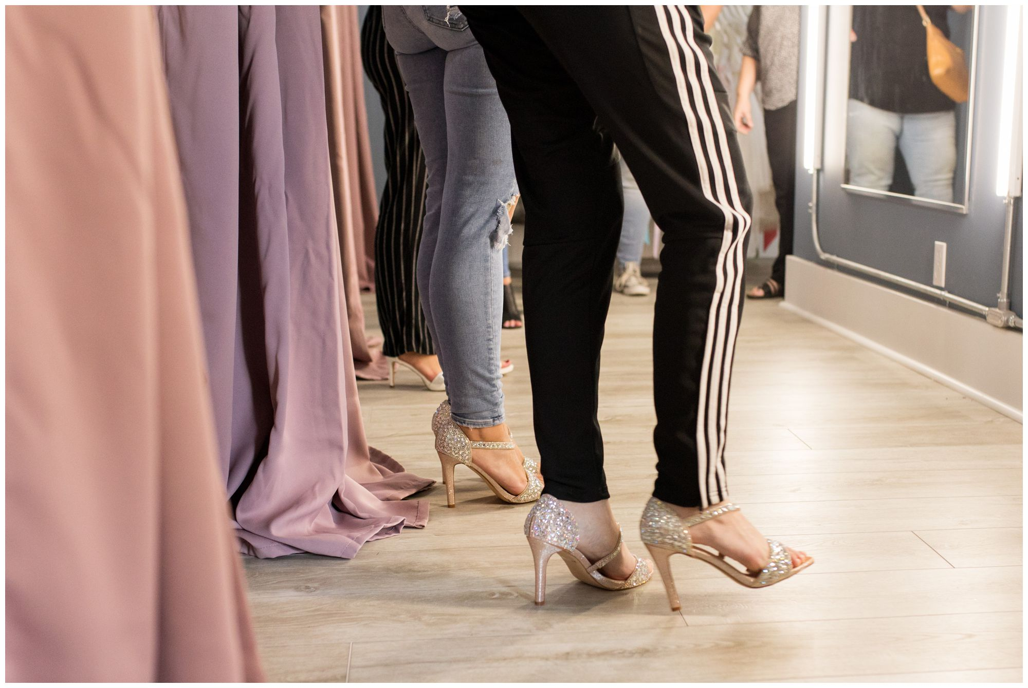girls trying on shoes for the Blye's Bridal fashion show
