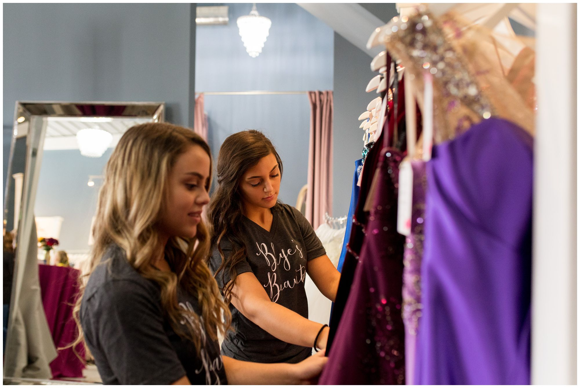 high school girls looking through formal dresses before Blye's Bridal fashion show