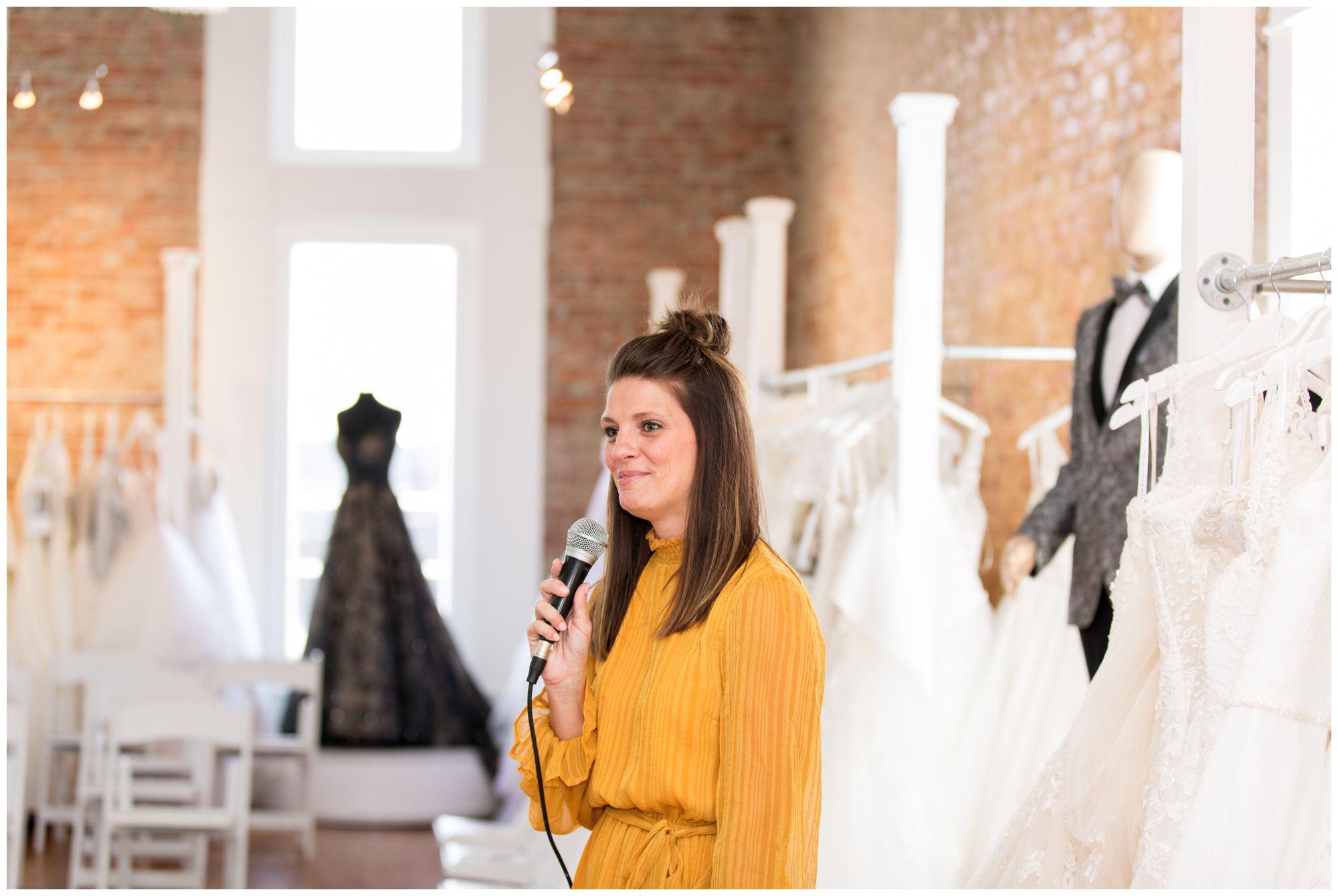 Allison Crim emceeing the Blye's Bridal fashion show