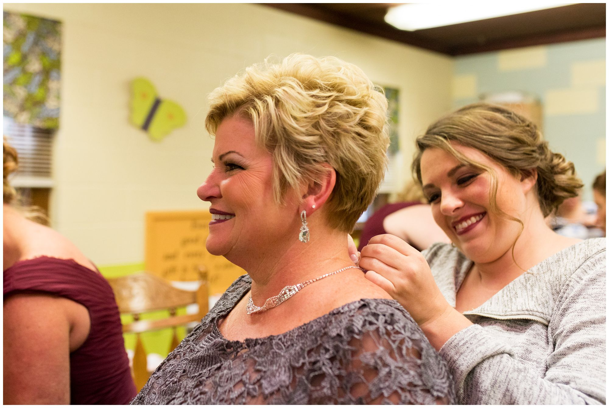 bride puts mom's necklace on at Zion Lutheran Church