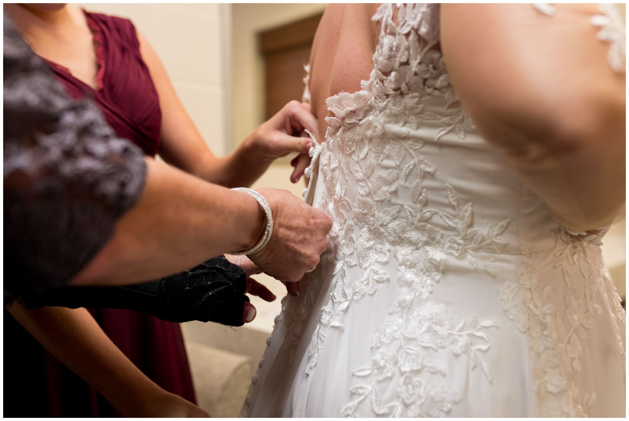 bridesmaids and mom help bride into dress at Zion Lutheran Church in Decatur