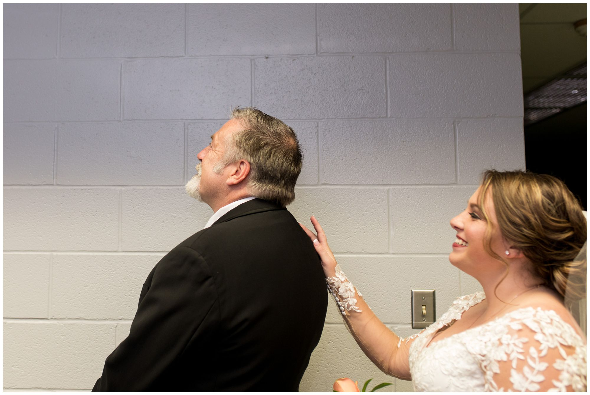 bride has first look with dad before wedding ceremony at Zion Lutheran Church