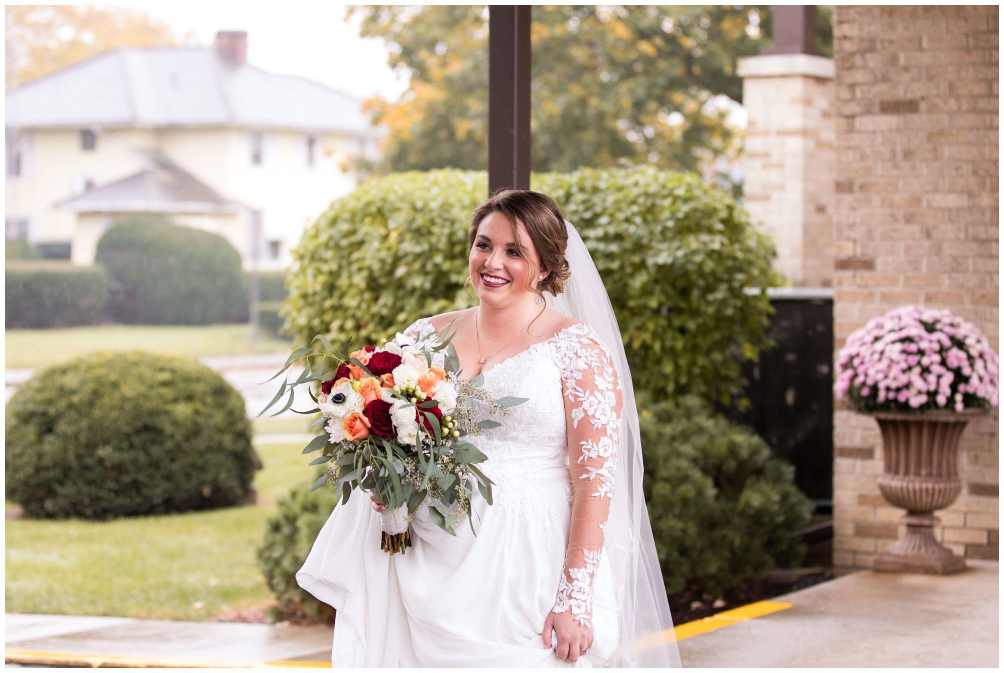 bride walks toward groom during first look in Decatur, Indiana