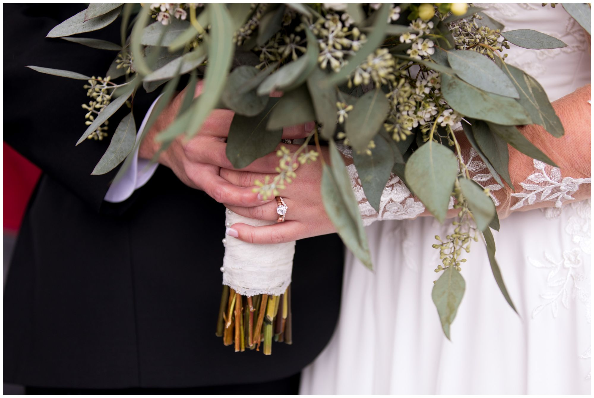 bride and groom's hands together holding bouquet in Decatur, Indiana
