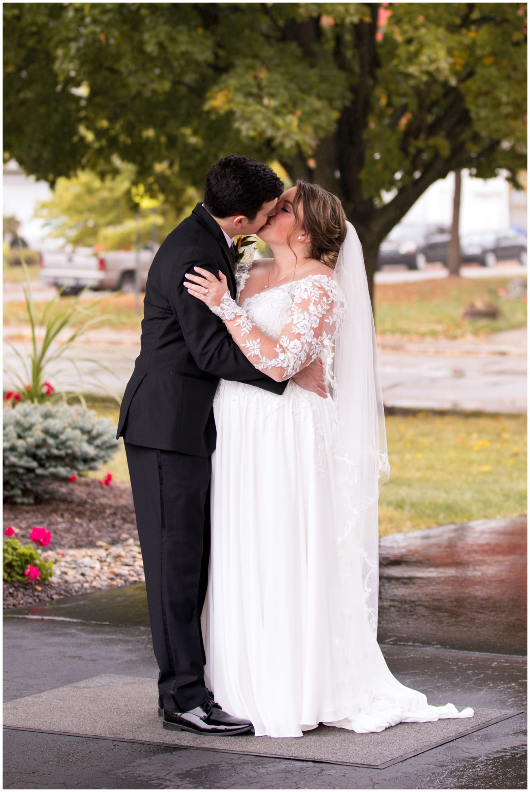 bride and groom kiss during wedding portraits in Decatur, Indiana