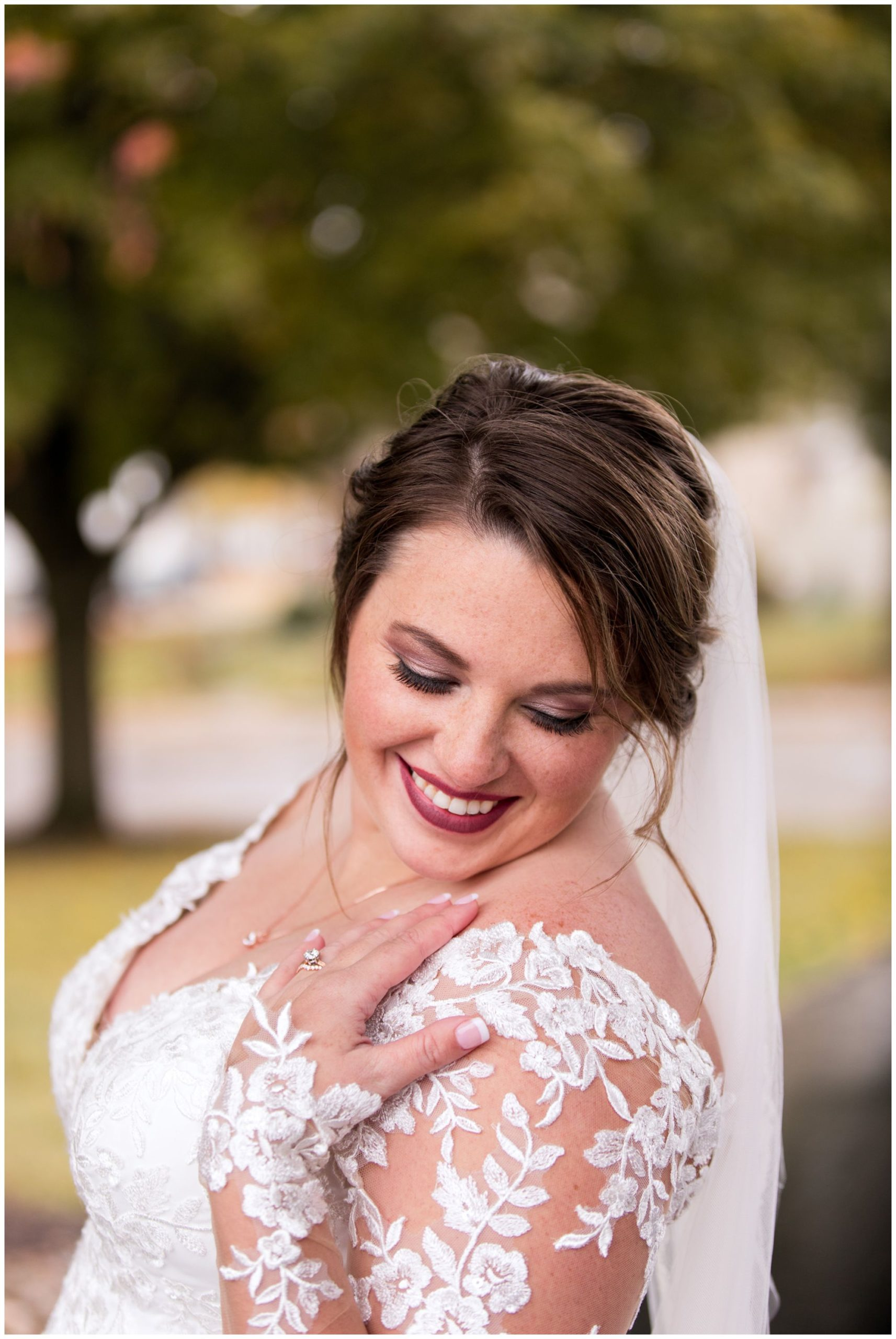 bride smiles while looking down shoulder in Decatur Indiana