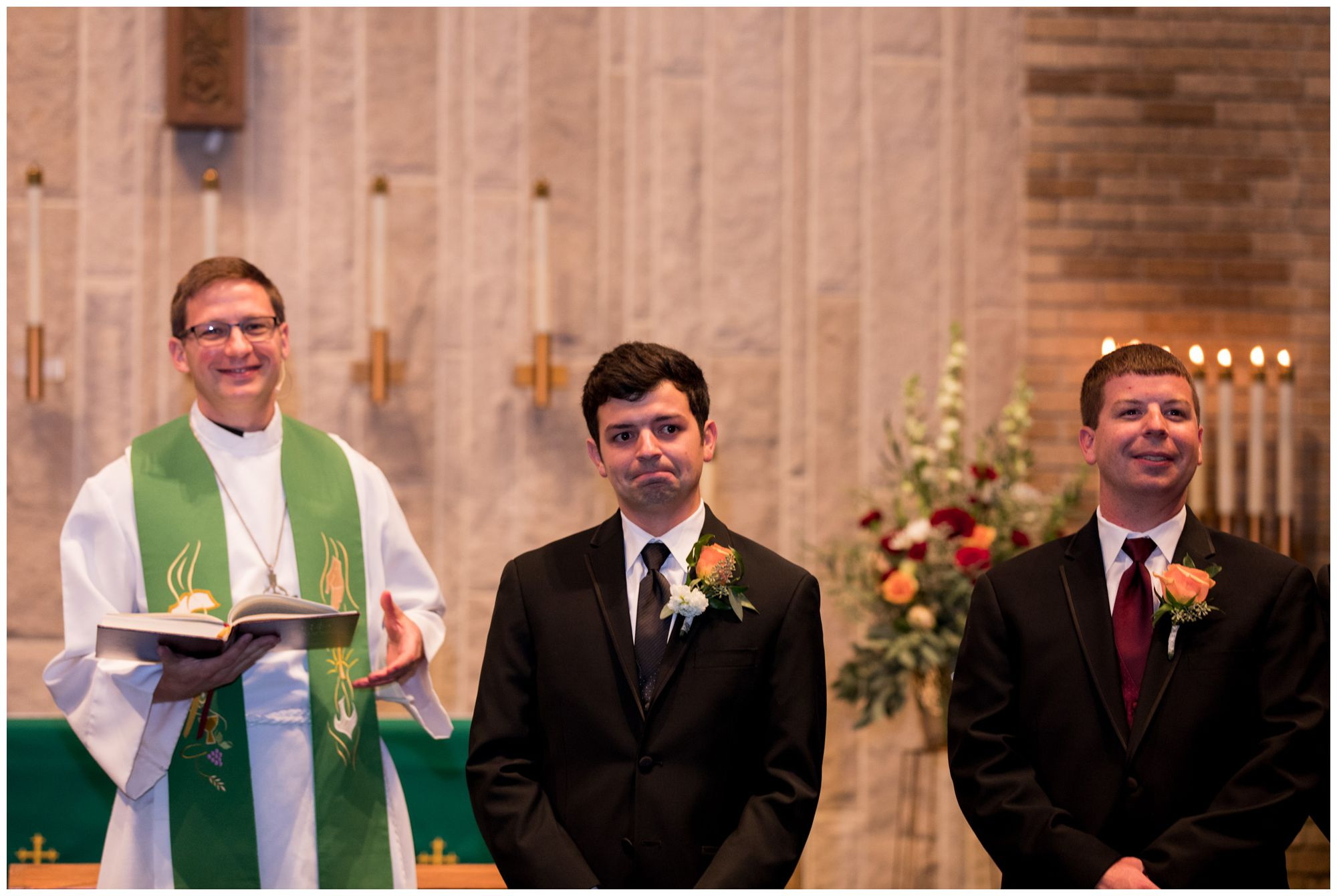 groom turns to see bride walking down aisle during Zion Lutheran Church wedding ceremony