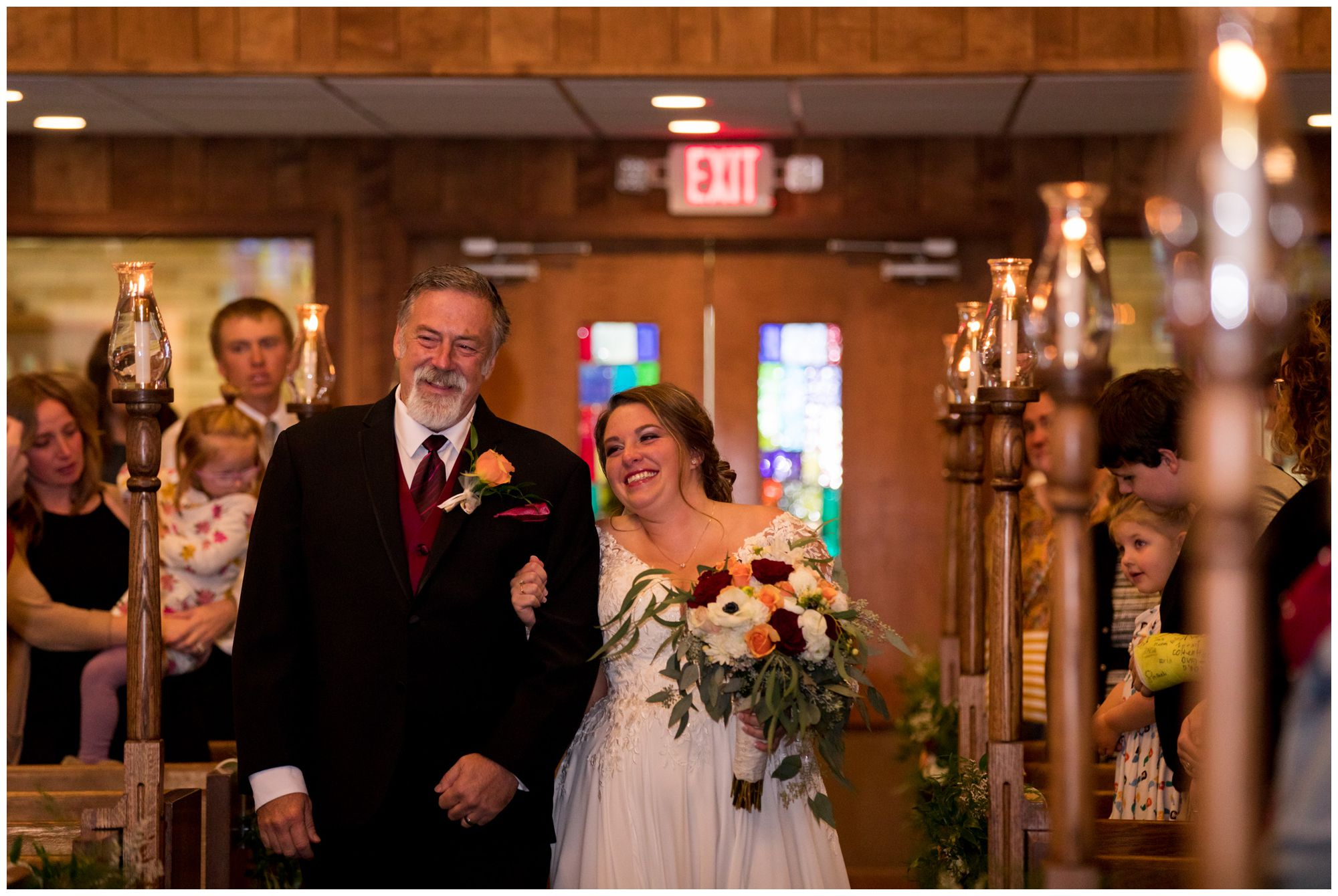 bride and father walking down aisle during wedding ceremony at Zion Lutheran Church